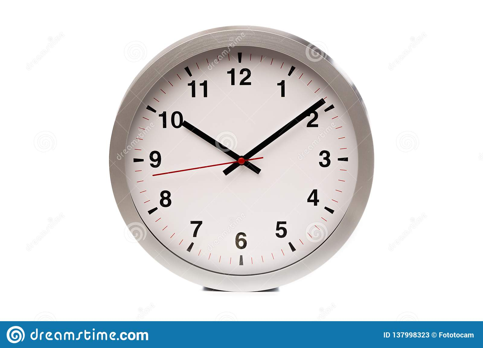 A big white clock shows the time - Image