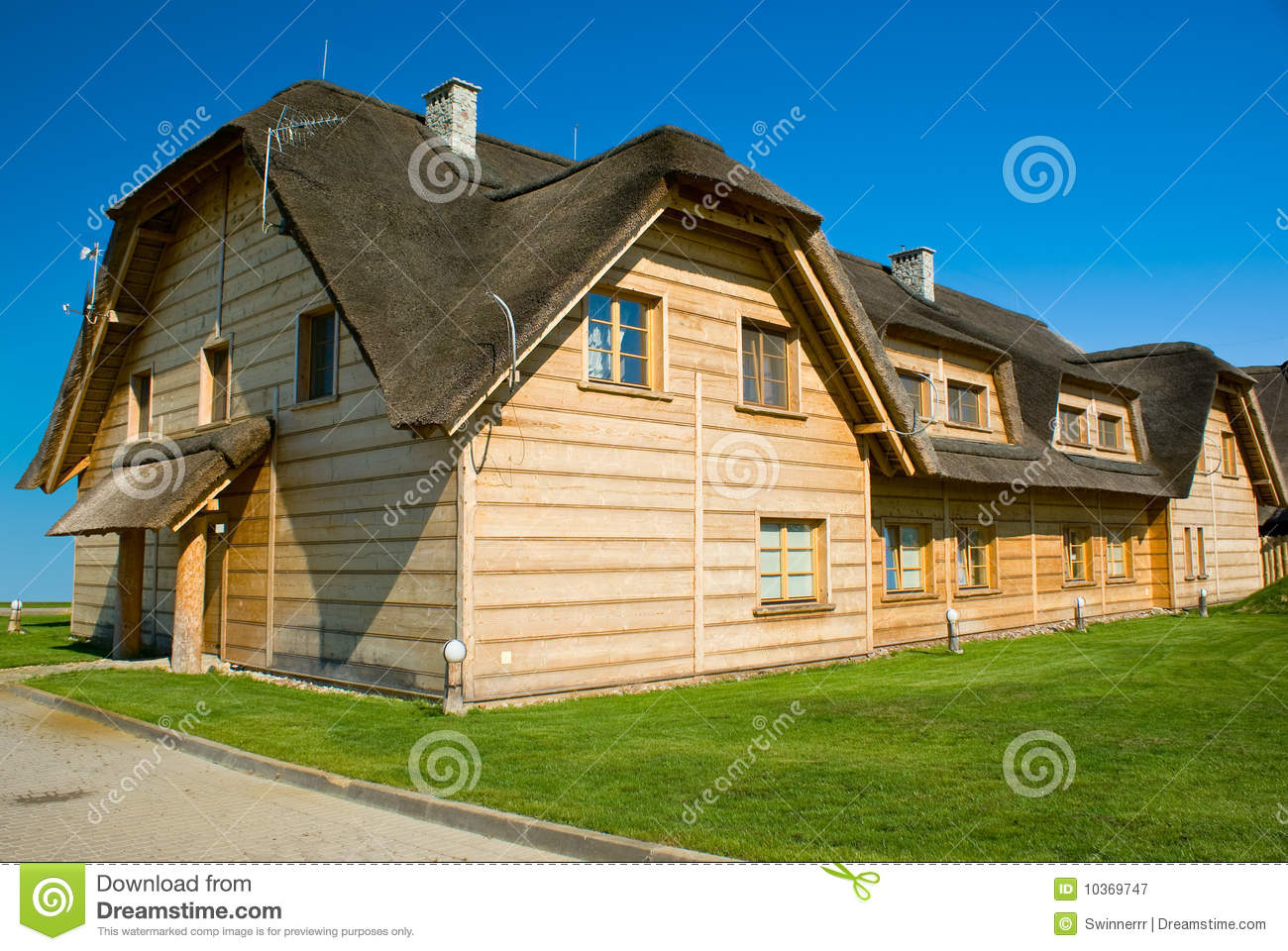 Big Wooden House With Straw Roof Royalty Free Stock