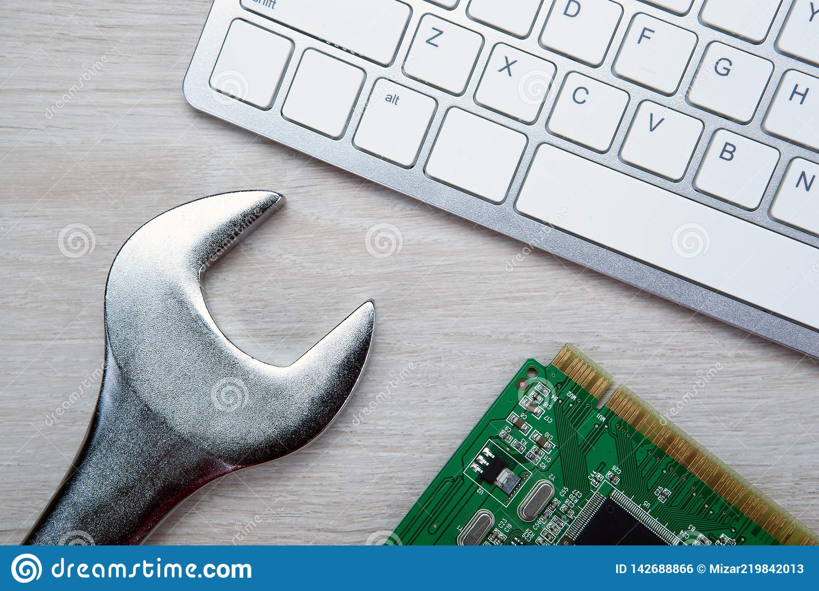 Big Wrench And A Computer Keyboard And Computer Parts Stock Photo Image Of Digit Information 142688866