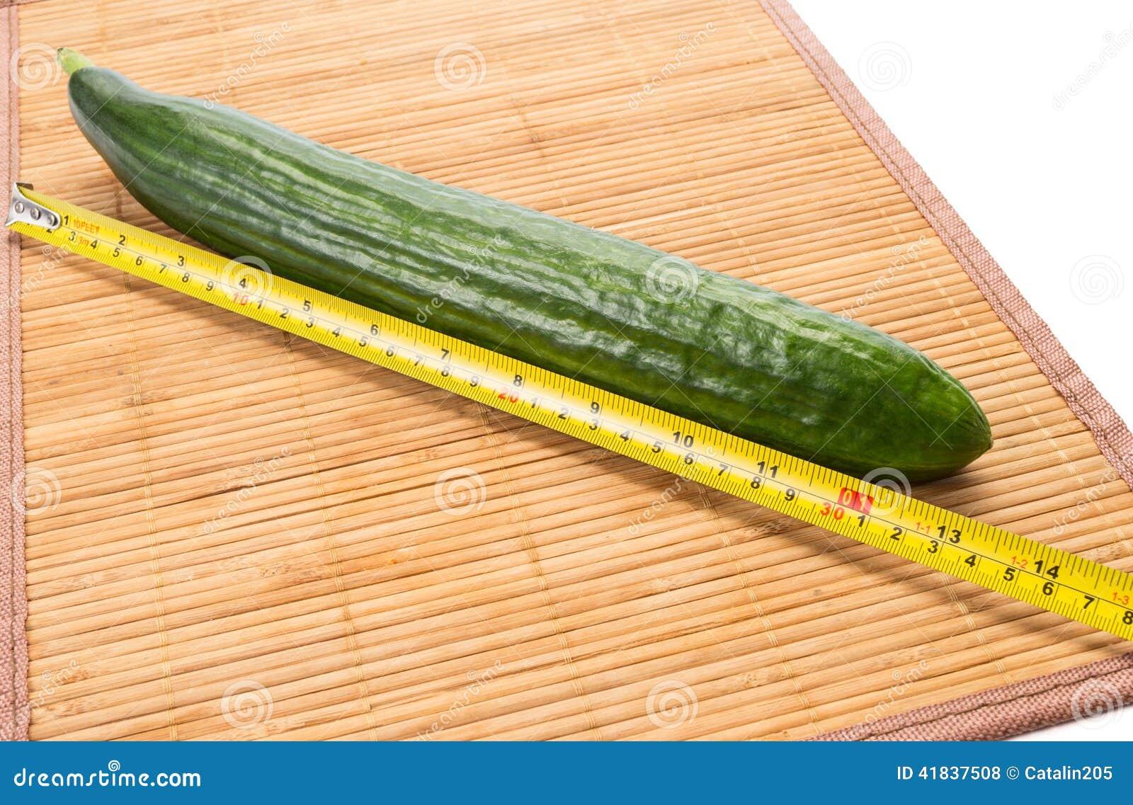 Big yellow centimeter and big green cucumber