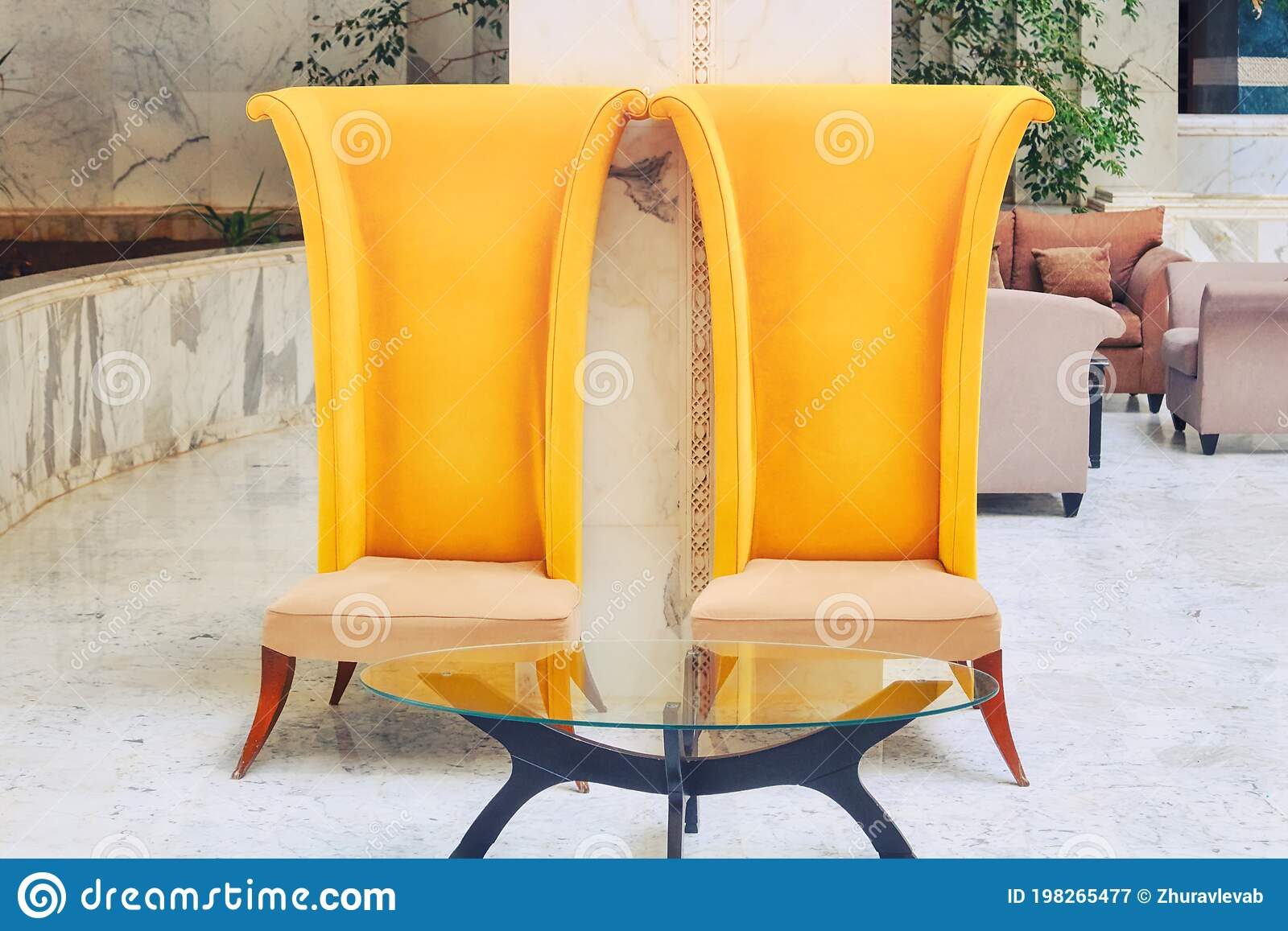 Big Yellow High Backed Chairs In The Hotel Lobby Furniture With A Glass Table In The Marble Interior Of The Hotel Stock Image Image Of Kitchen Luxury 198265477