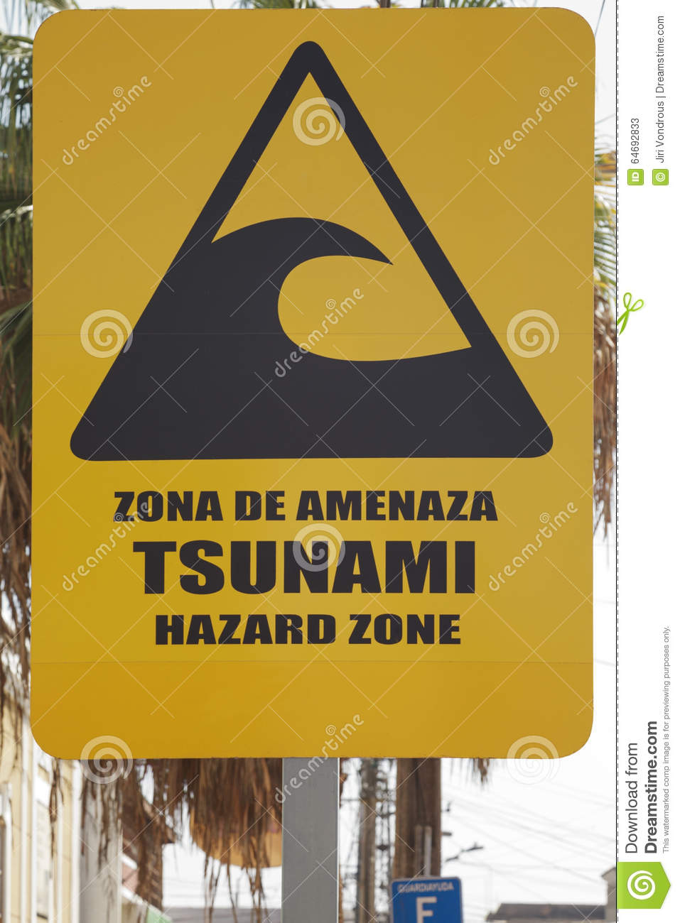 Big yellow tsunami warning sign on the street of Iquique Chile