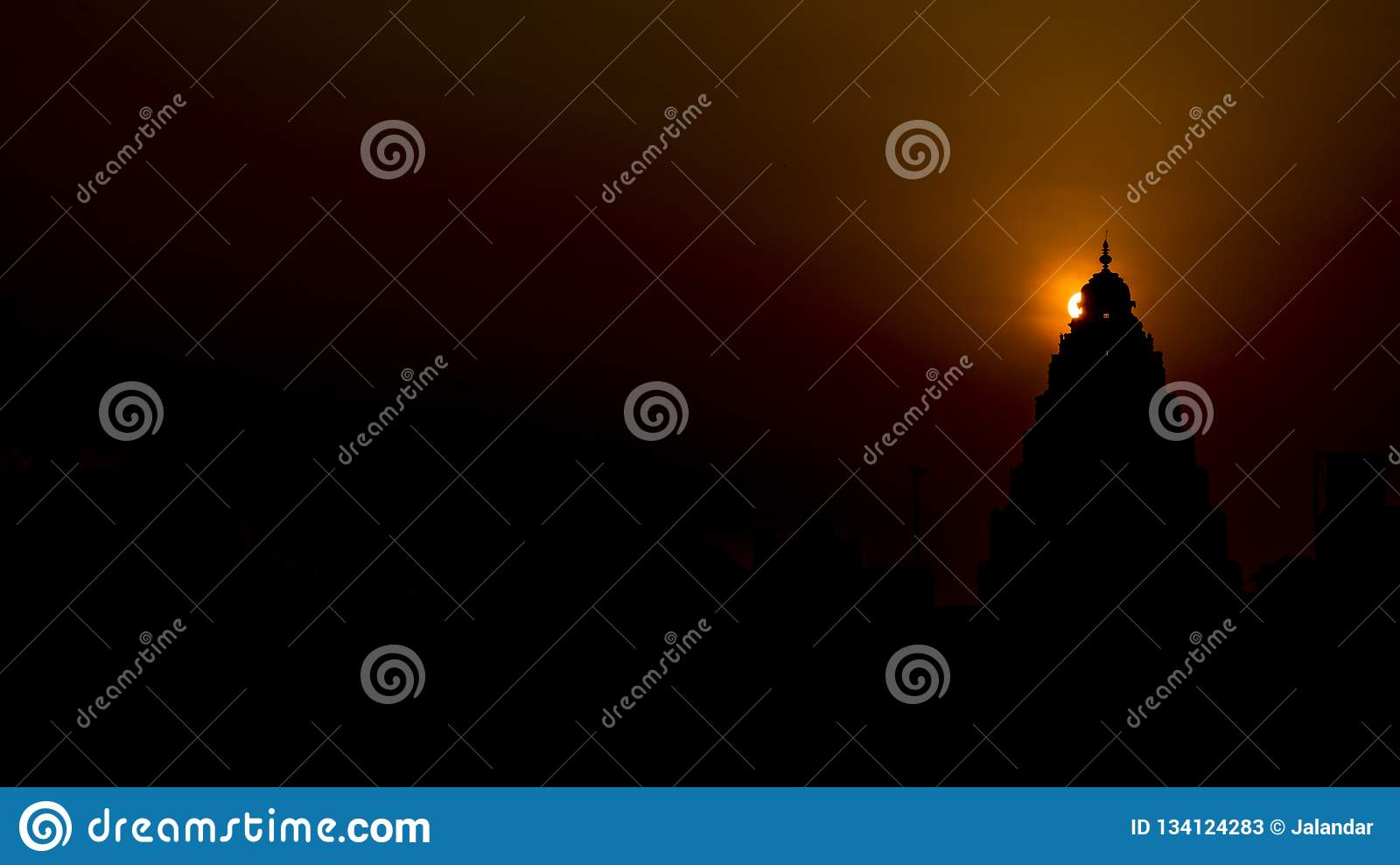 Sunrise : Halo behind the Top of a Hindu temple.