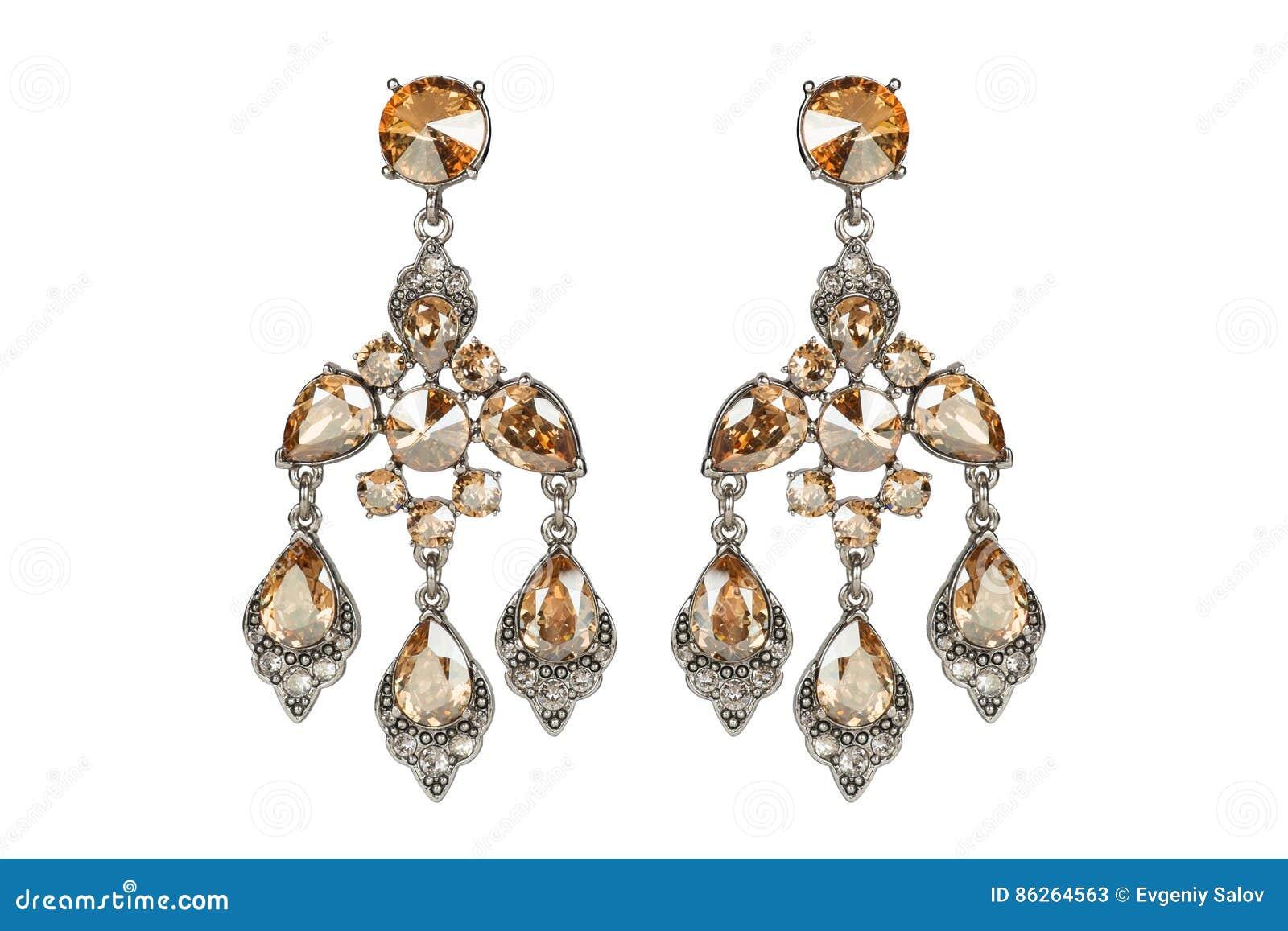 Bijoux sur un fond blanc Boucles d oreille du ` s de femmes de la meilleure qualité avec les pierres précieuses Bijoux d isolat B