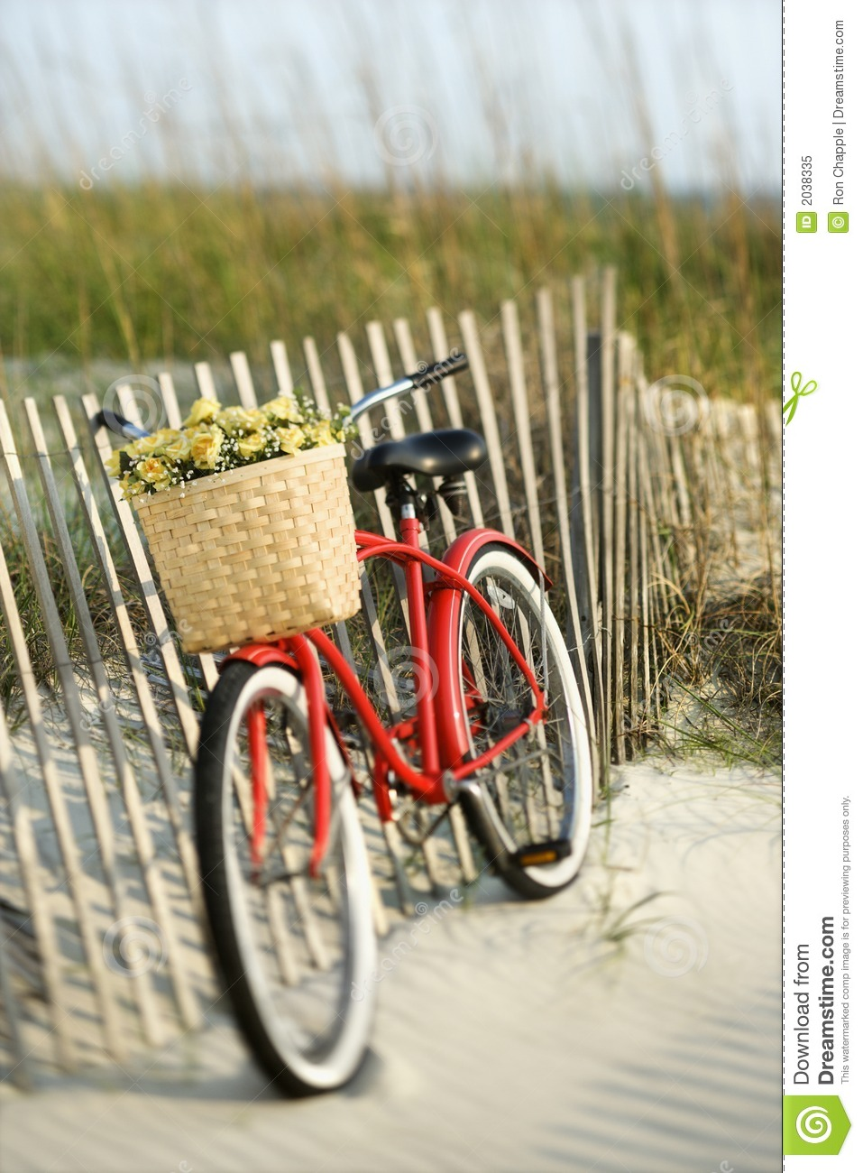 Bike Leaning Against Fence At Beach Royalty Free Stock