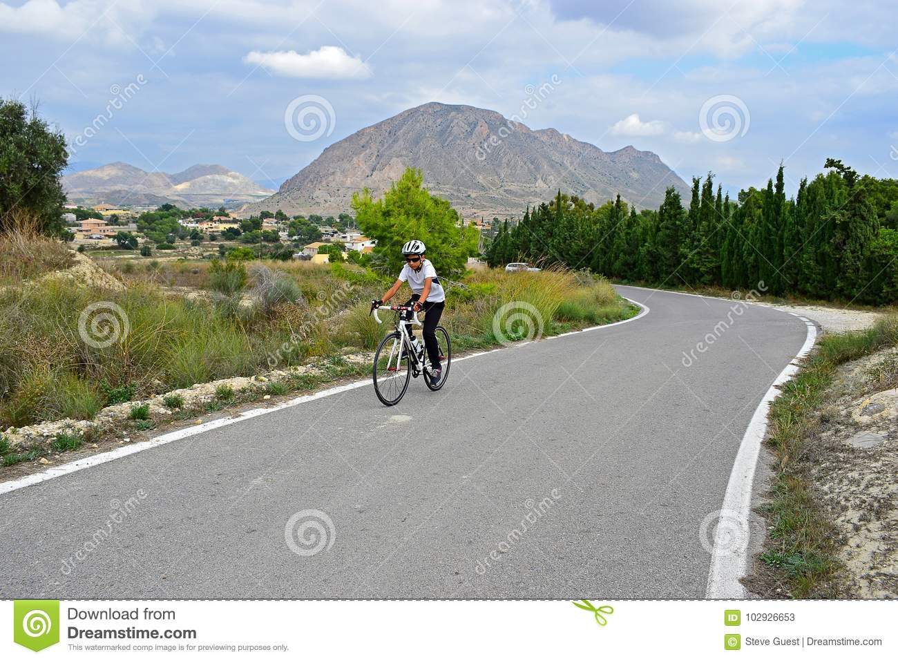 A Cyclist In The Mountains With Stunning Scenery