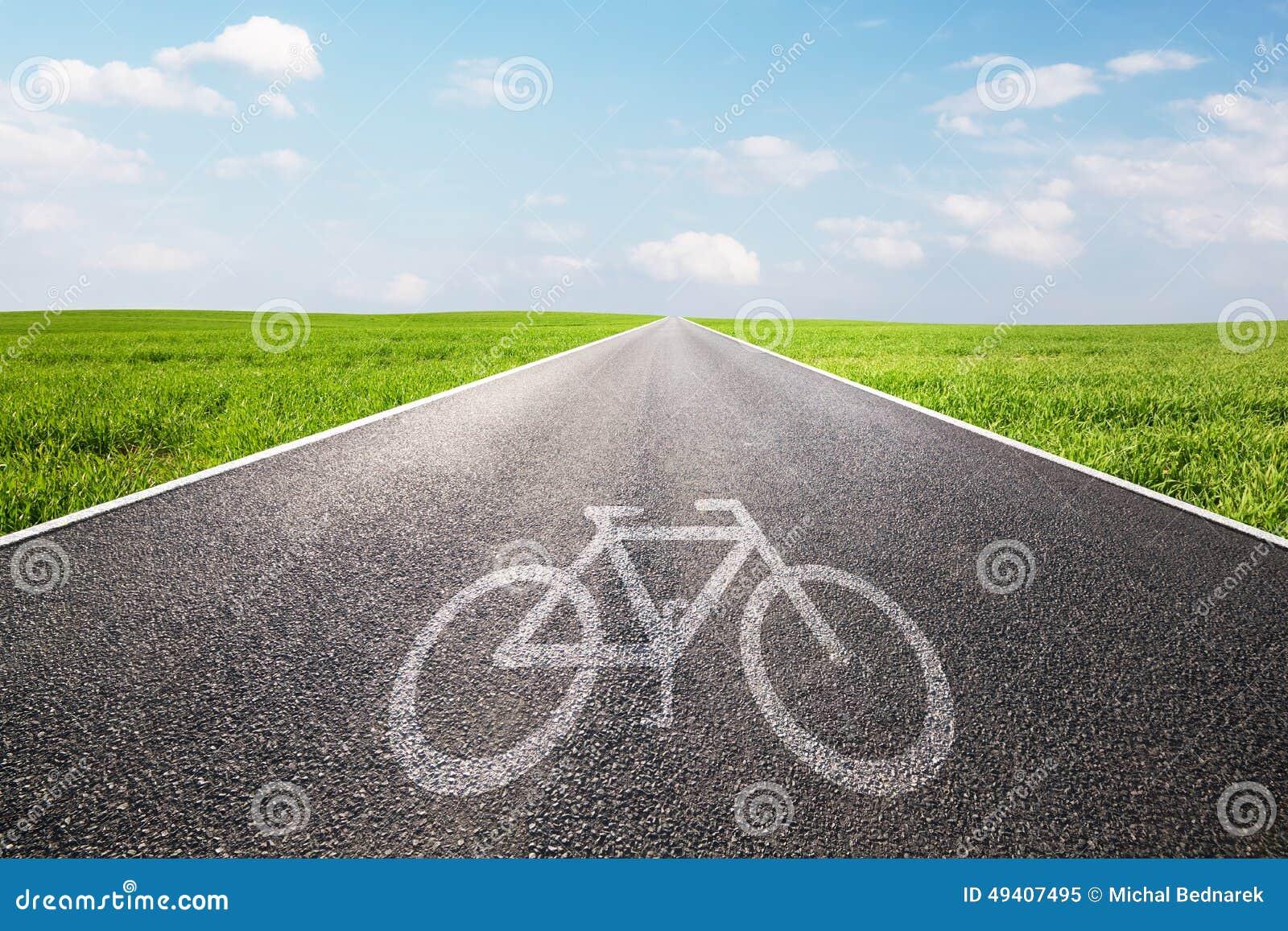 Bike symbol on long straight asphalt road, way