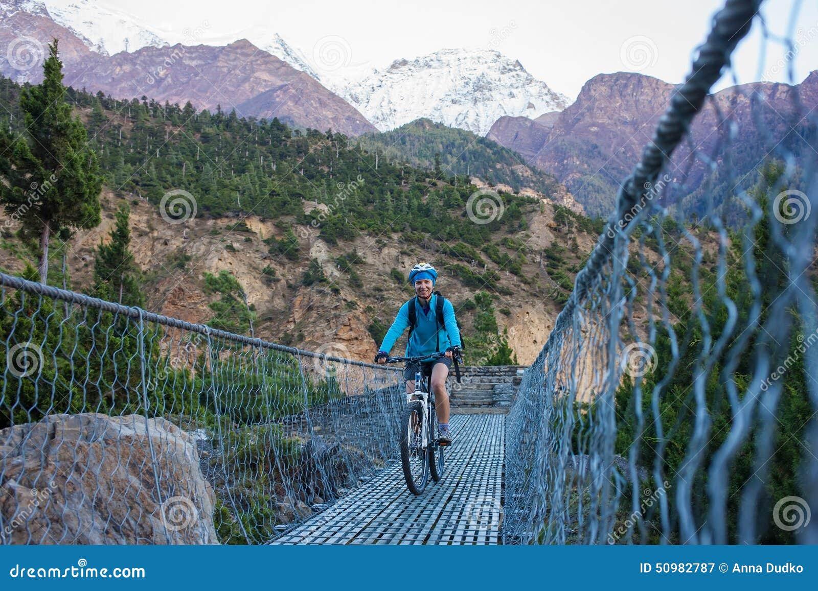 Biker-girl in Himalaya mountains