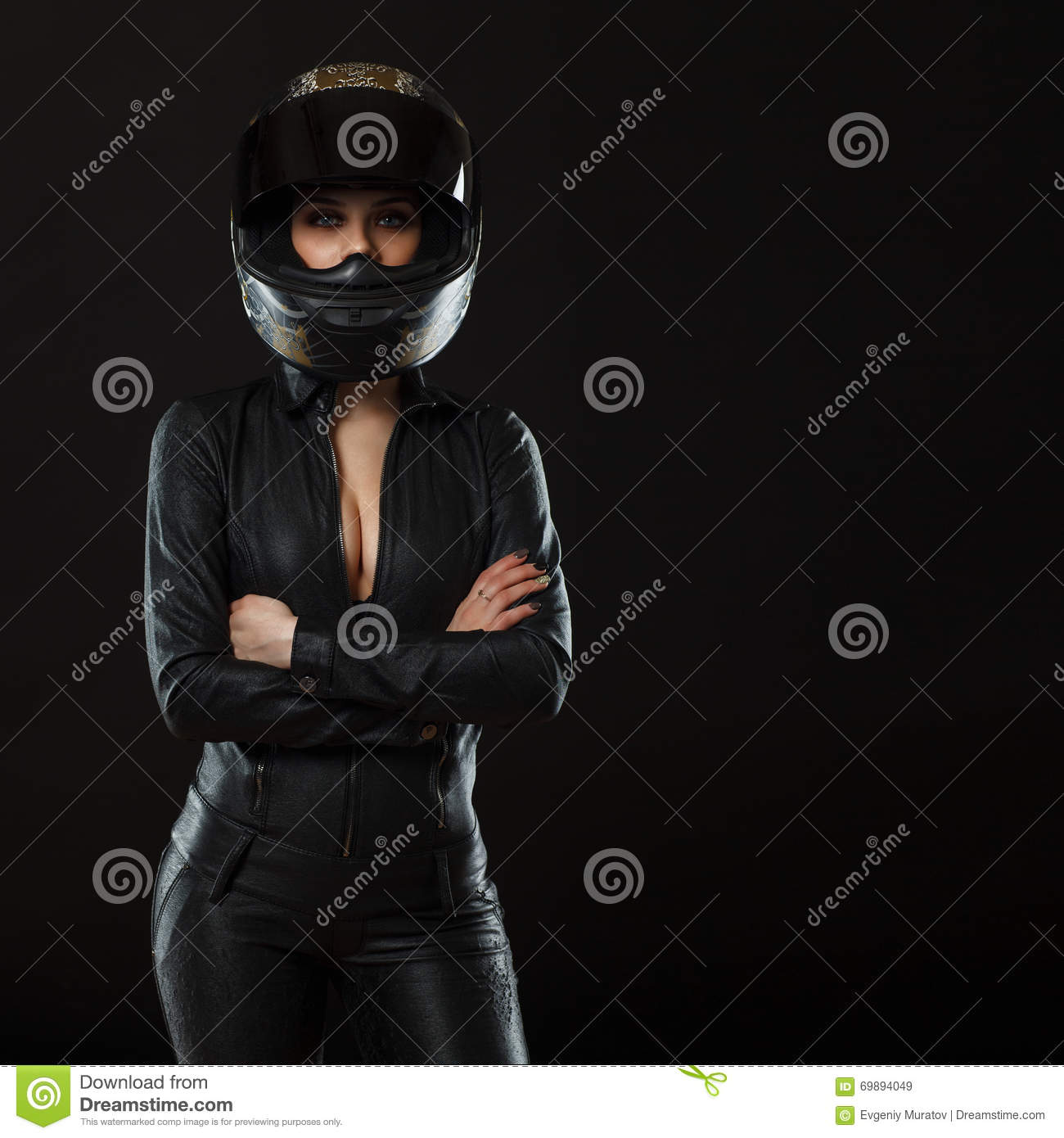 Biker girl posing in studio
