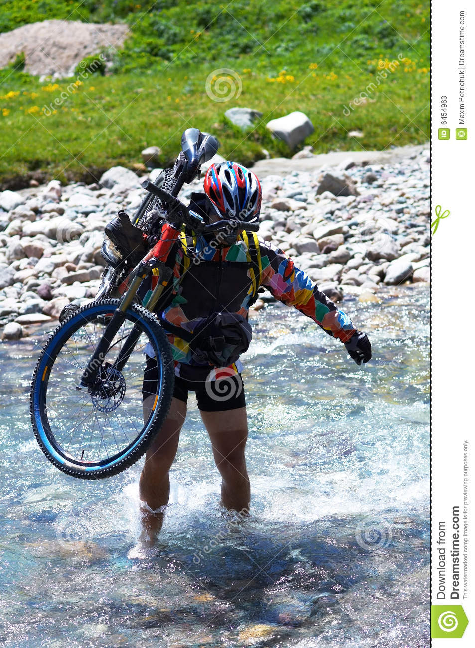 Biker and mountain river