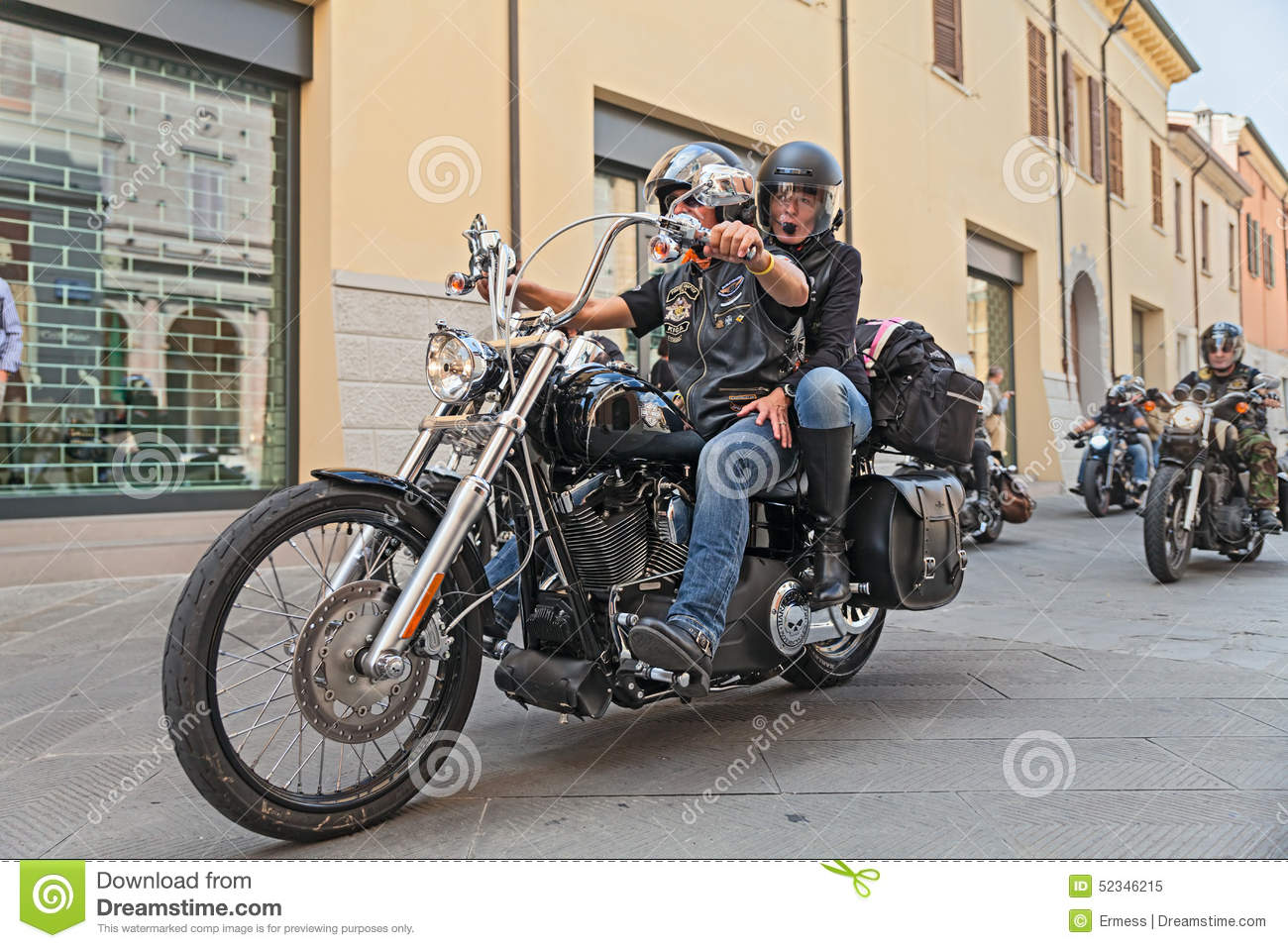 A couple on a harley davidson motorcycle editorial image image of bikers riding harley davidson royalty free stock photo kristyandbryce Image collections