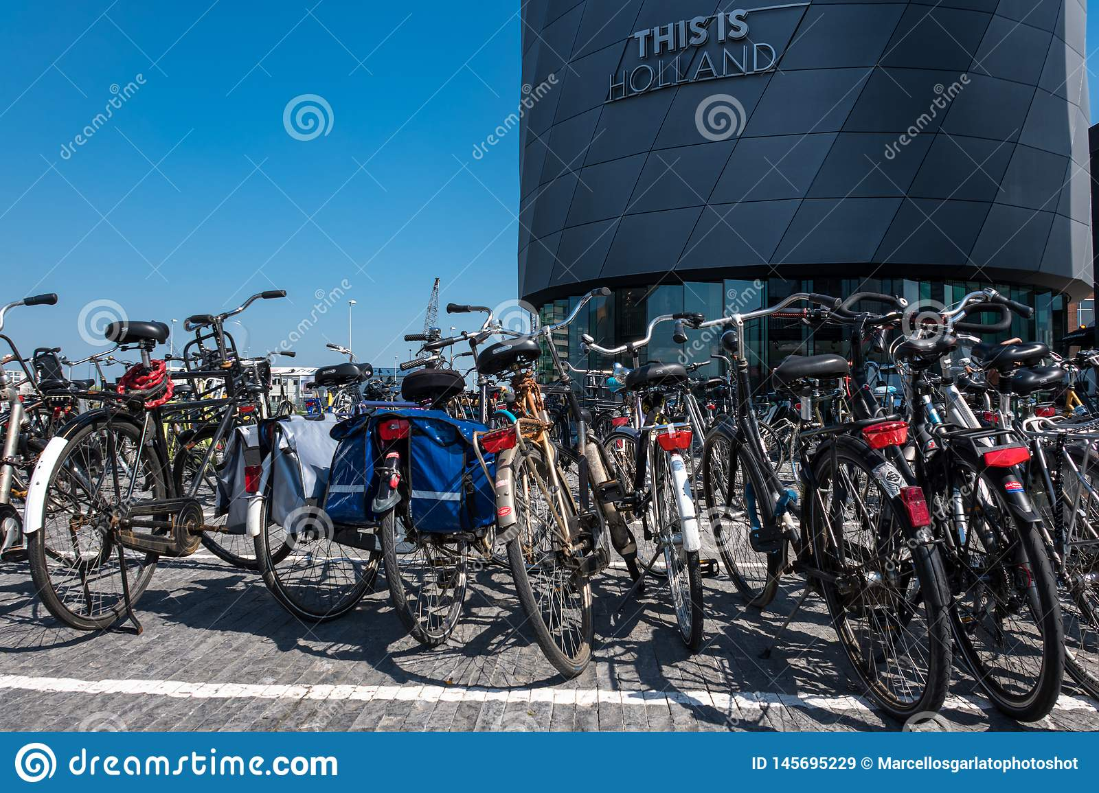 The bikes parking lot in front of the `This is Holland` building.