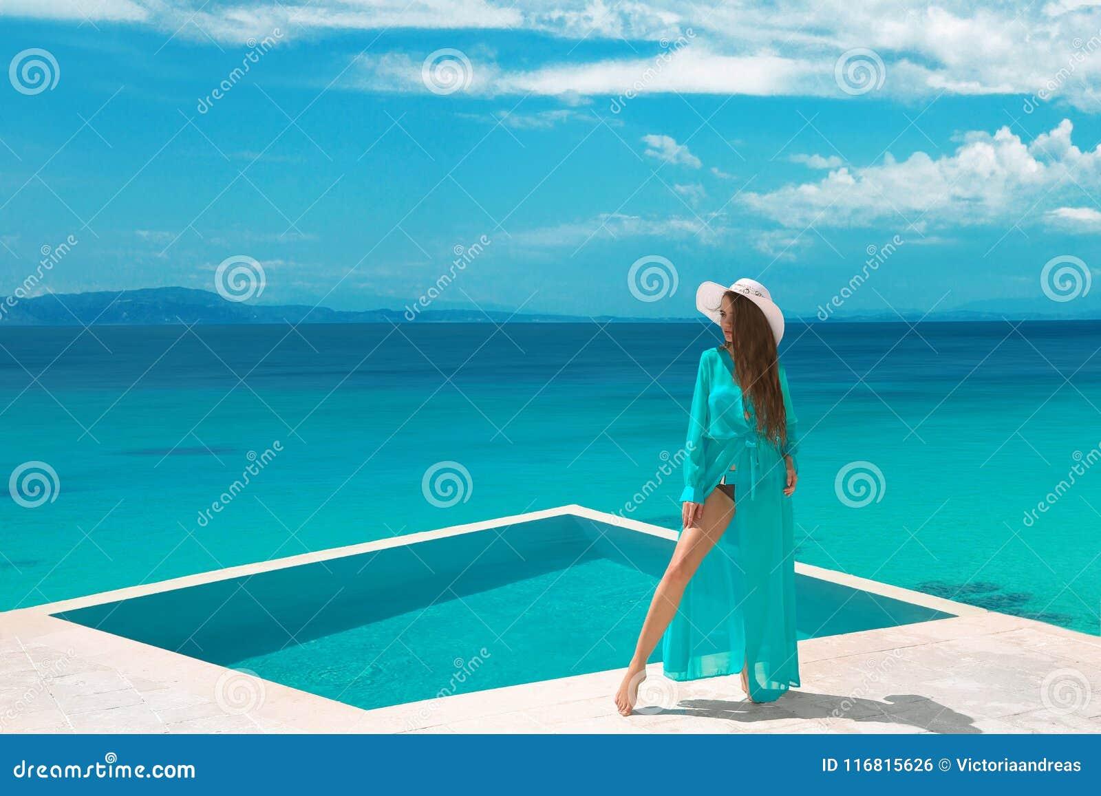 d9efdc0b81 Bikini carefree woman in swimwear enjoying honeymoon, girl relaxing by  infinity swimming pool at luxurious villa resort. Summer holiday idyllic  top view.
