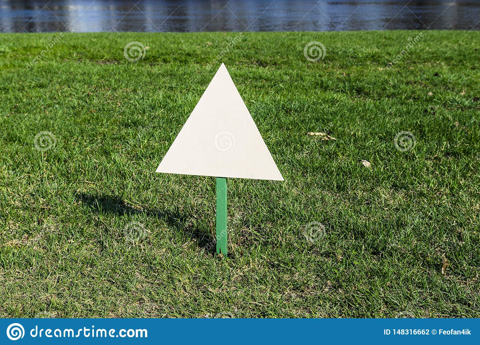 Billboard standing on the ground in the Park on the lawn, white advertising