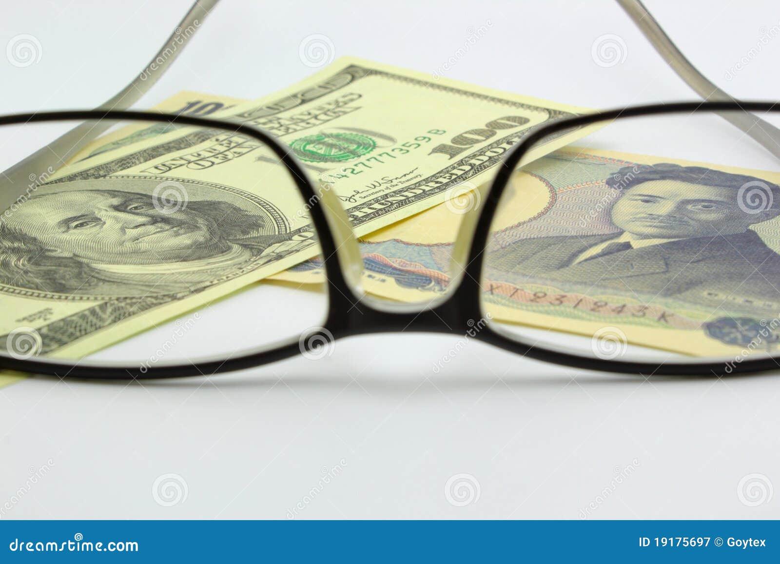 Billet d un dollar et Yens avec le monocle