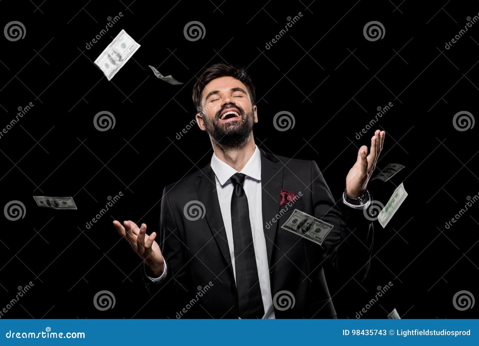 Billetes de banco del dólar del hombre de negocios que lanzan emocionado rico hermoso,