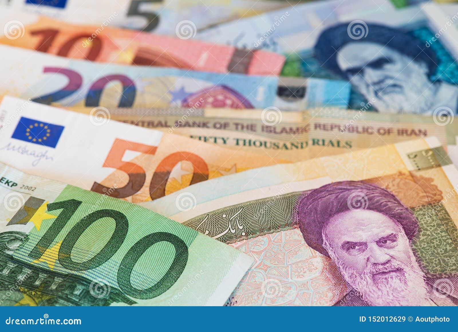 Billetes de banco euro de la moneda y billetes de banco de la moneda del rial iraní cercanos encima de imagen