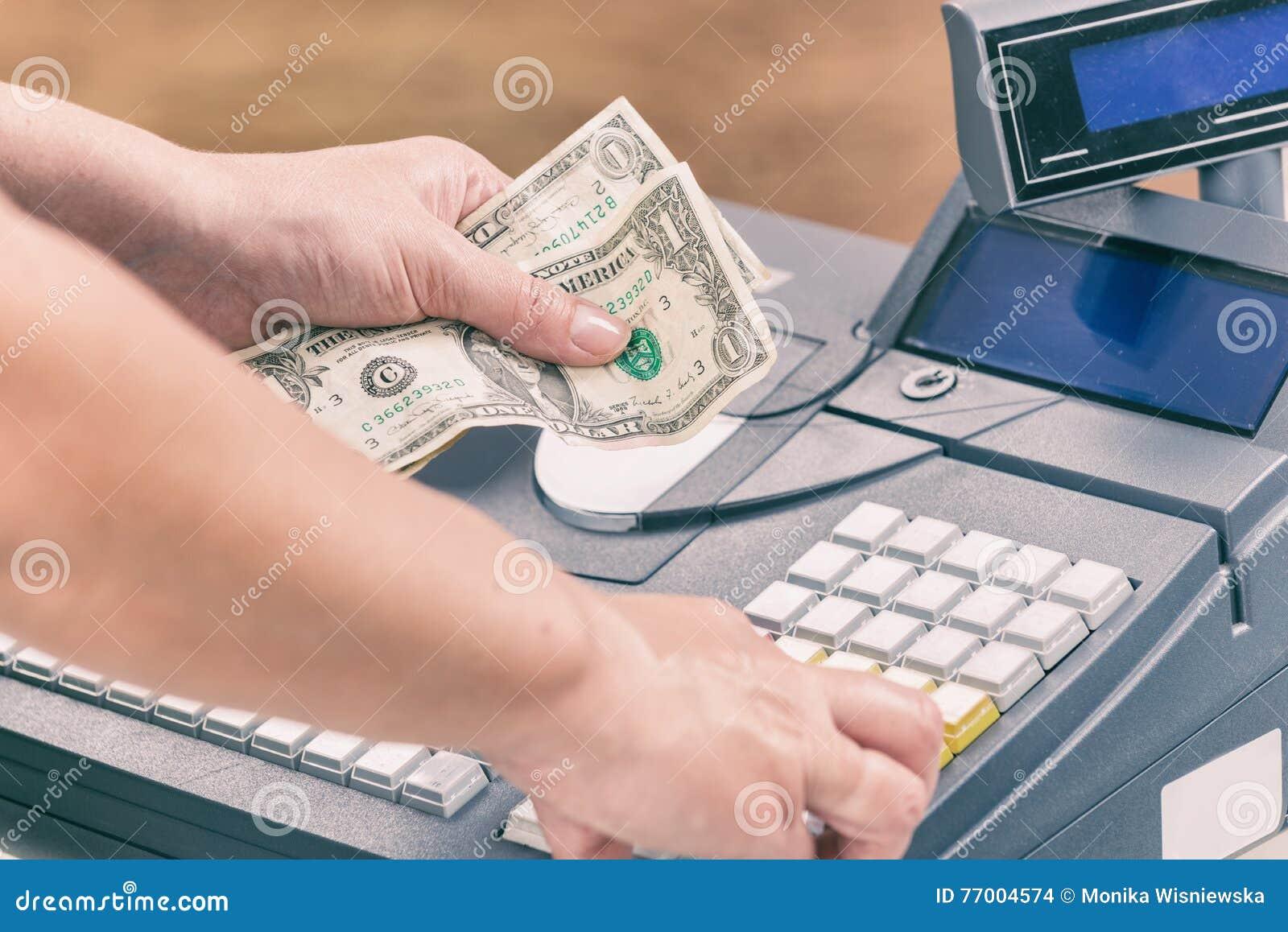 Billets de banque de holdnig de caissier