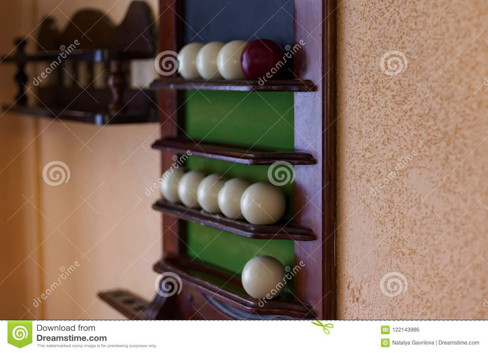 Billiard balls on a Board on the wall