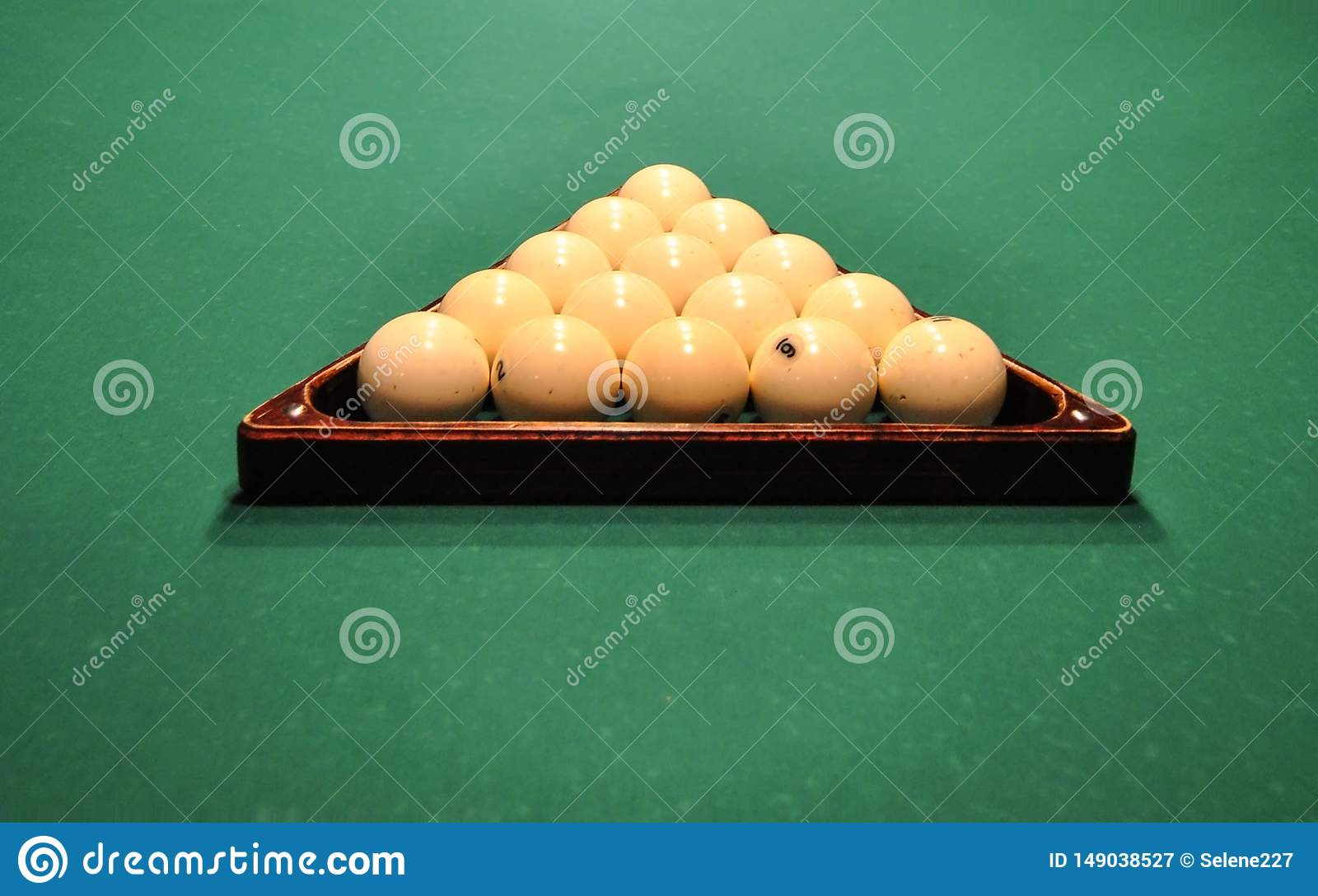 Billiard balls in wooden triangle