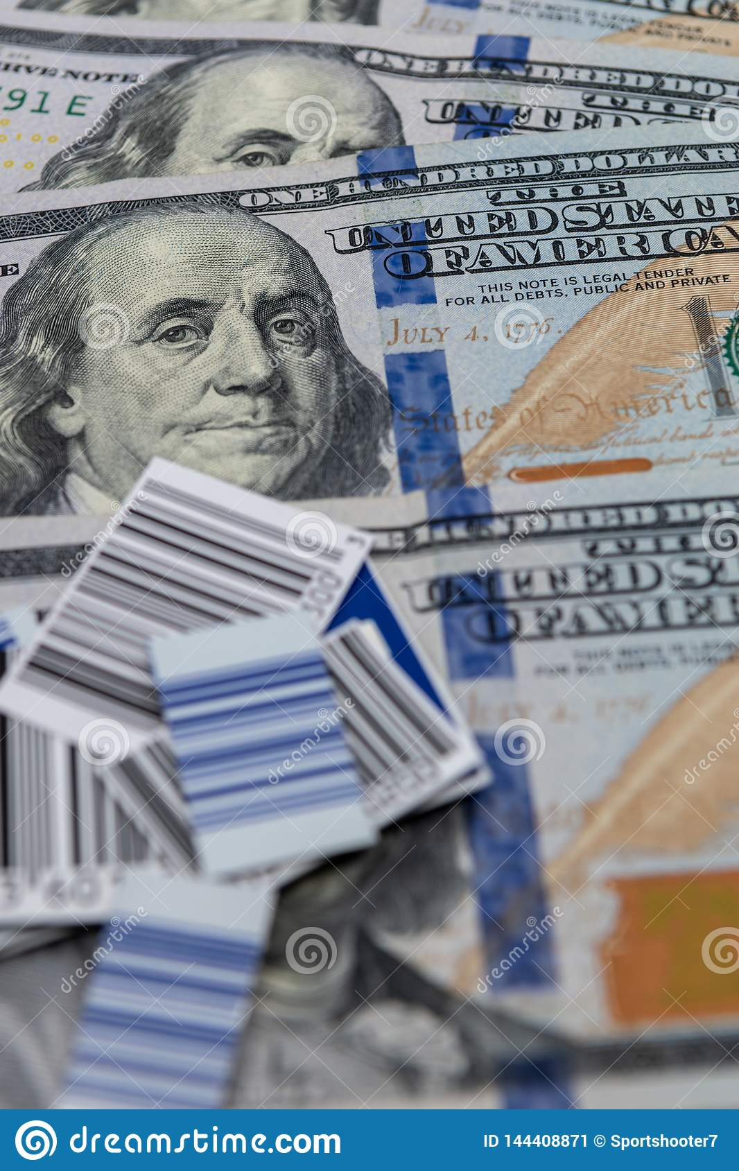 UPC codes against $100 bills background - image