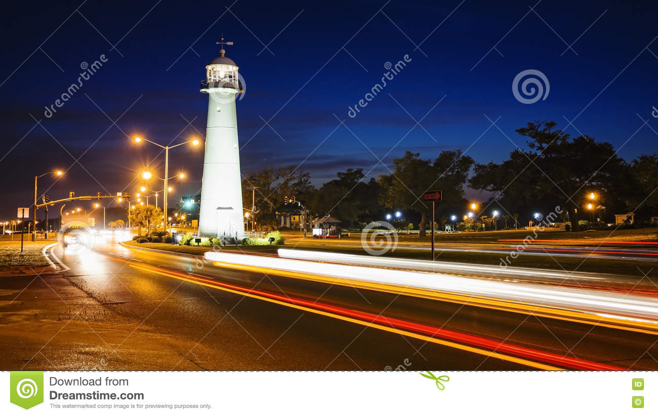 Biloxi Lighthouse At Night And Traffic In The Gulf Coast State O