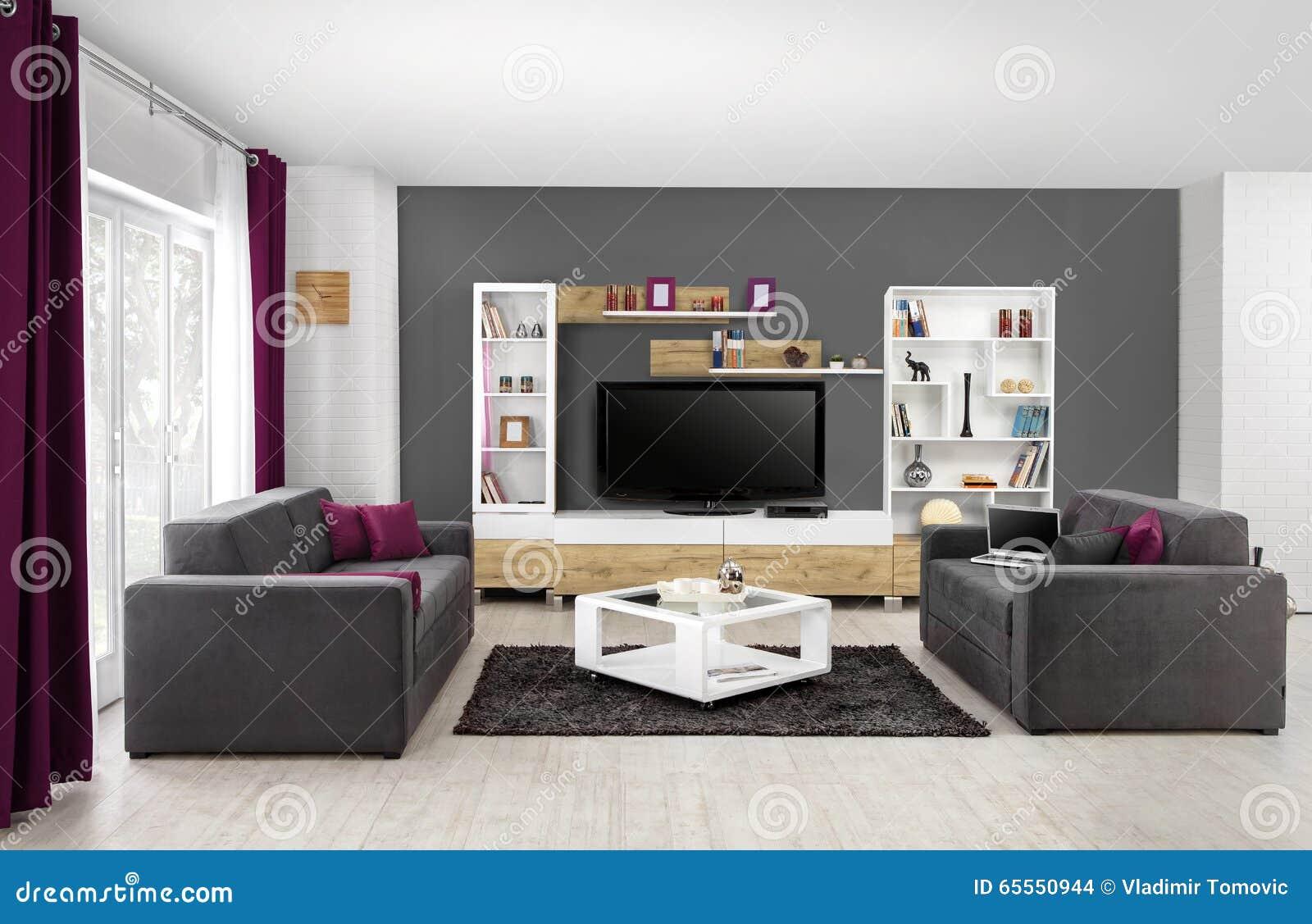 Binnenland van een moderne woonkamer in kleur stock foto
