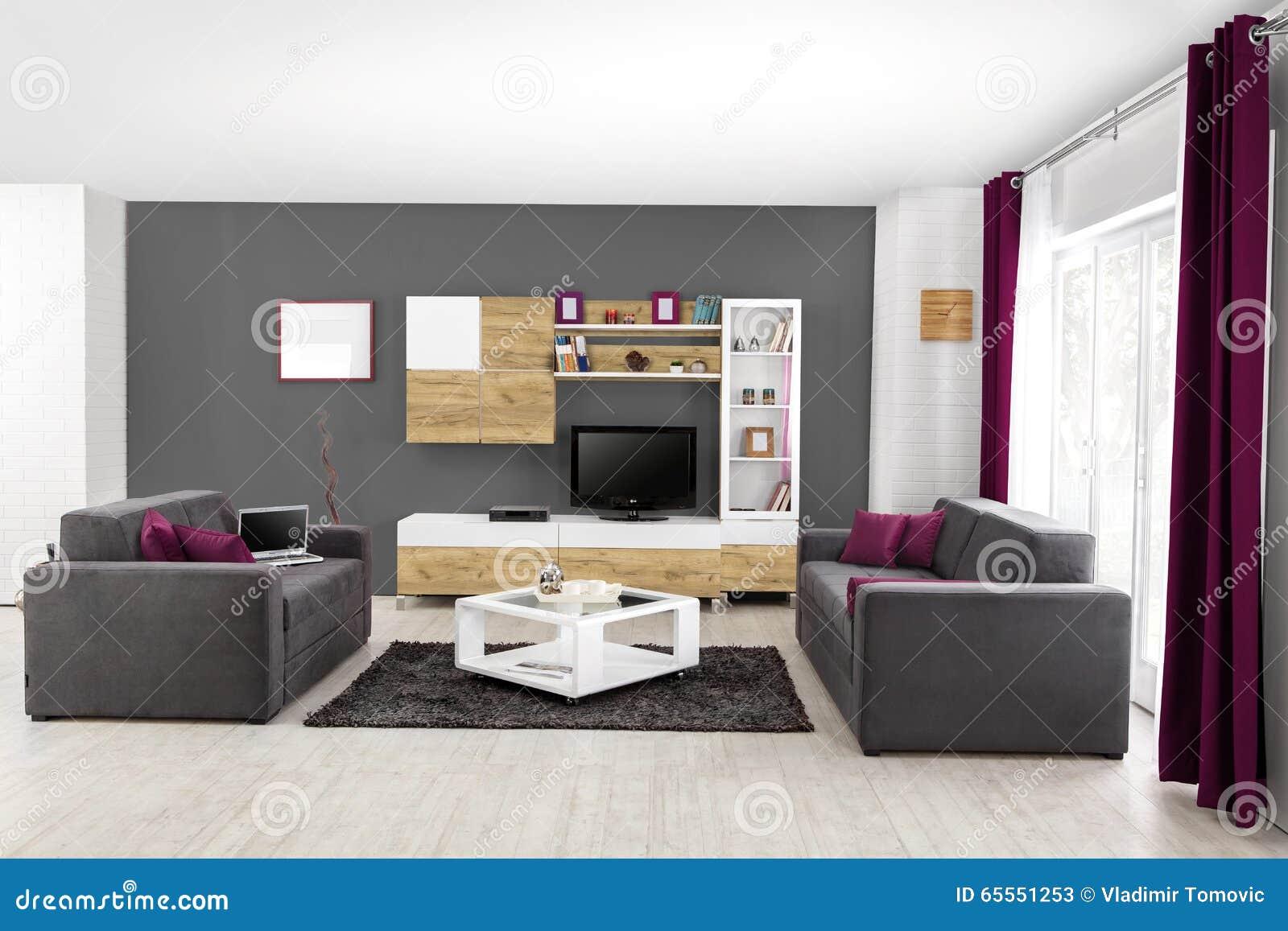Binnenland van een moderne woonkamer in kleur stock afbeelding