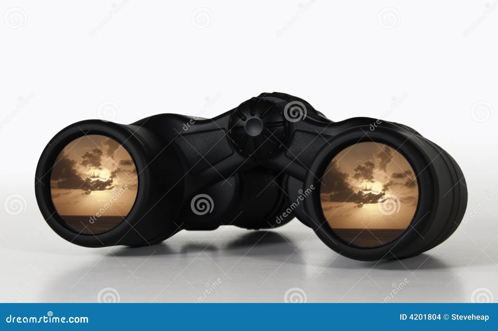 Binoculars showing distant sunset