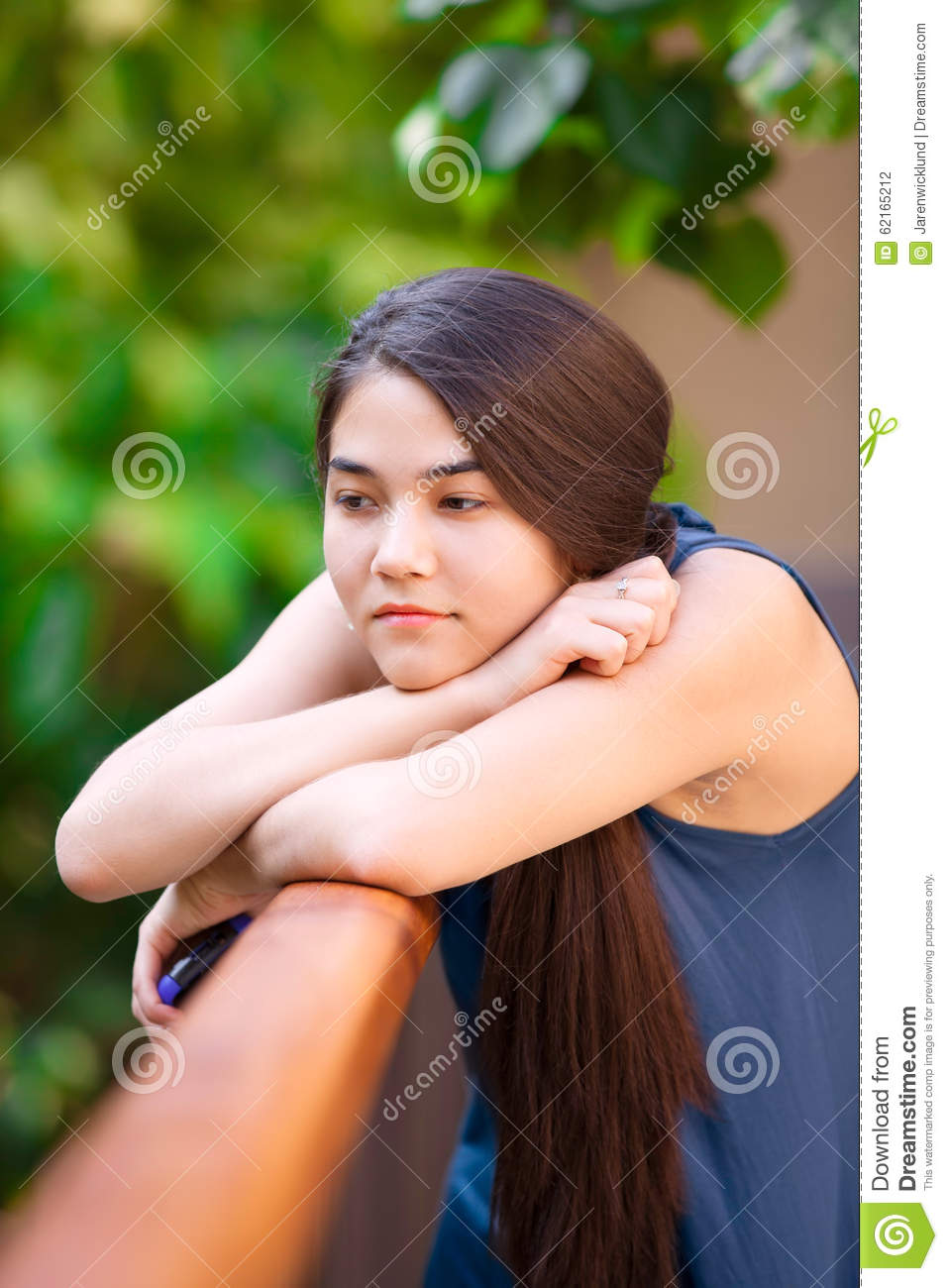 Prime Biracial Teen Girl Holding Cellphone Leaning On Railing Thinki Hairstyle Inspiration Daily Dogsangcom