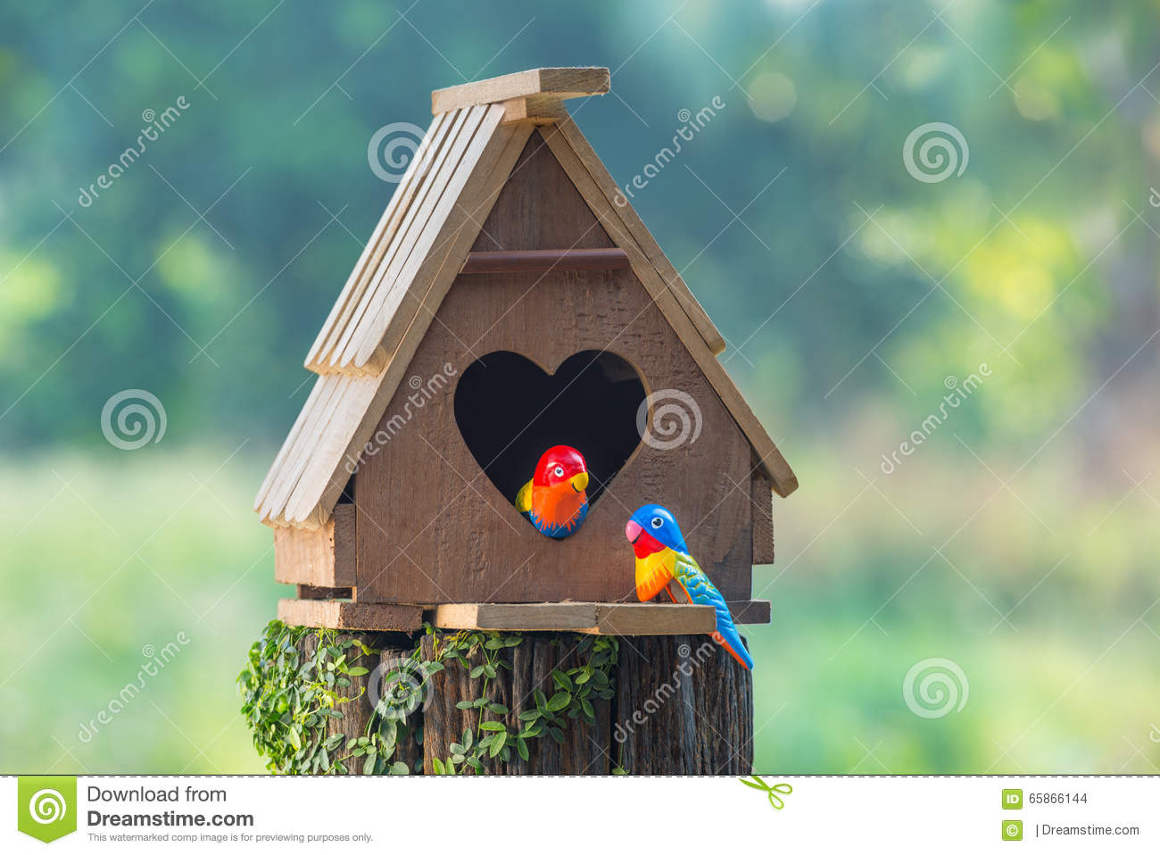 Birdhouse have a heart-shaped entrance and two love bird made fr