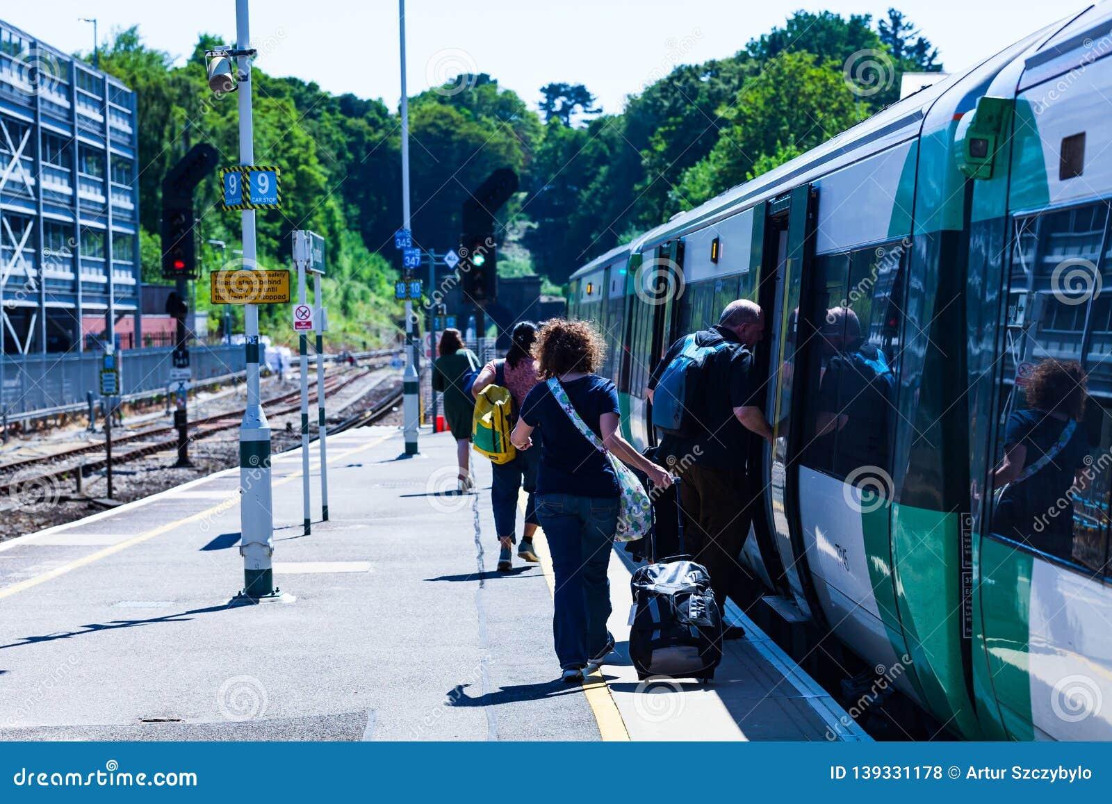 BIRMINGHAM, UK - March 2018 Commuters On Platform Boarding A
