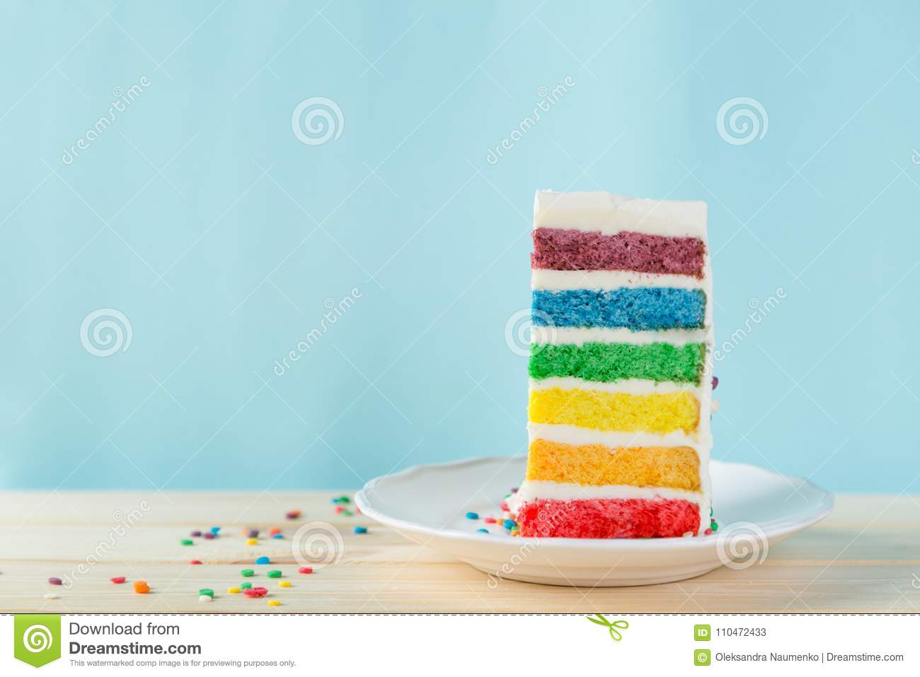 Birthday Background Striped Rainbow Cake With White Frosting Stock