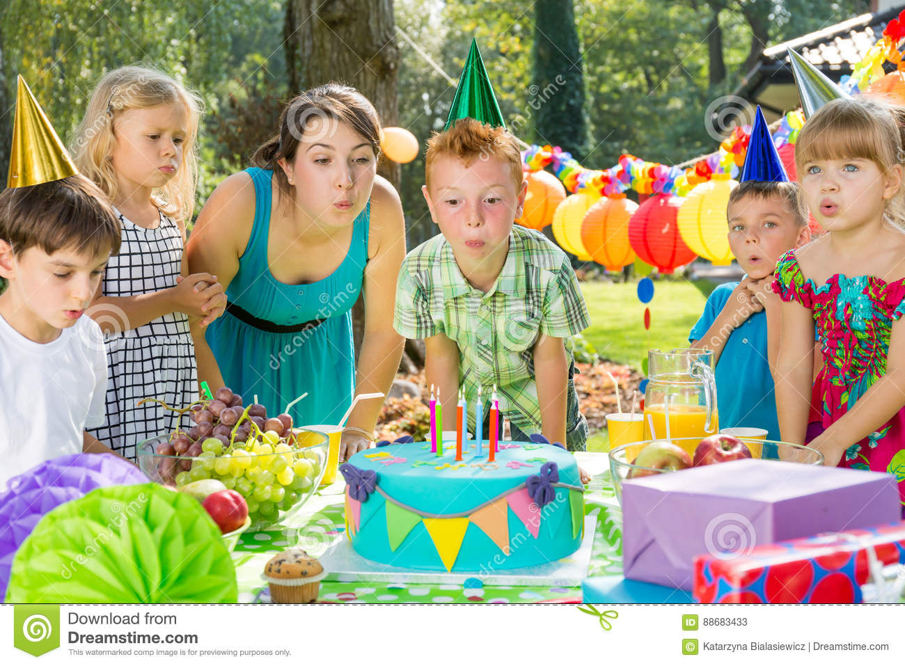 Birthday boy blowing up candles