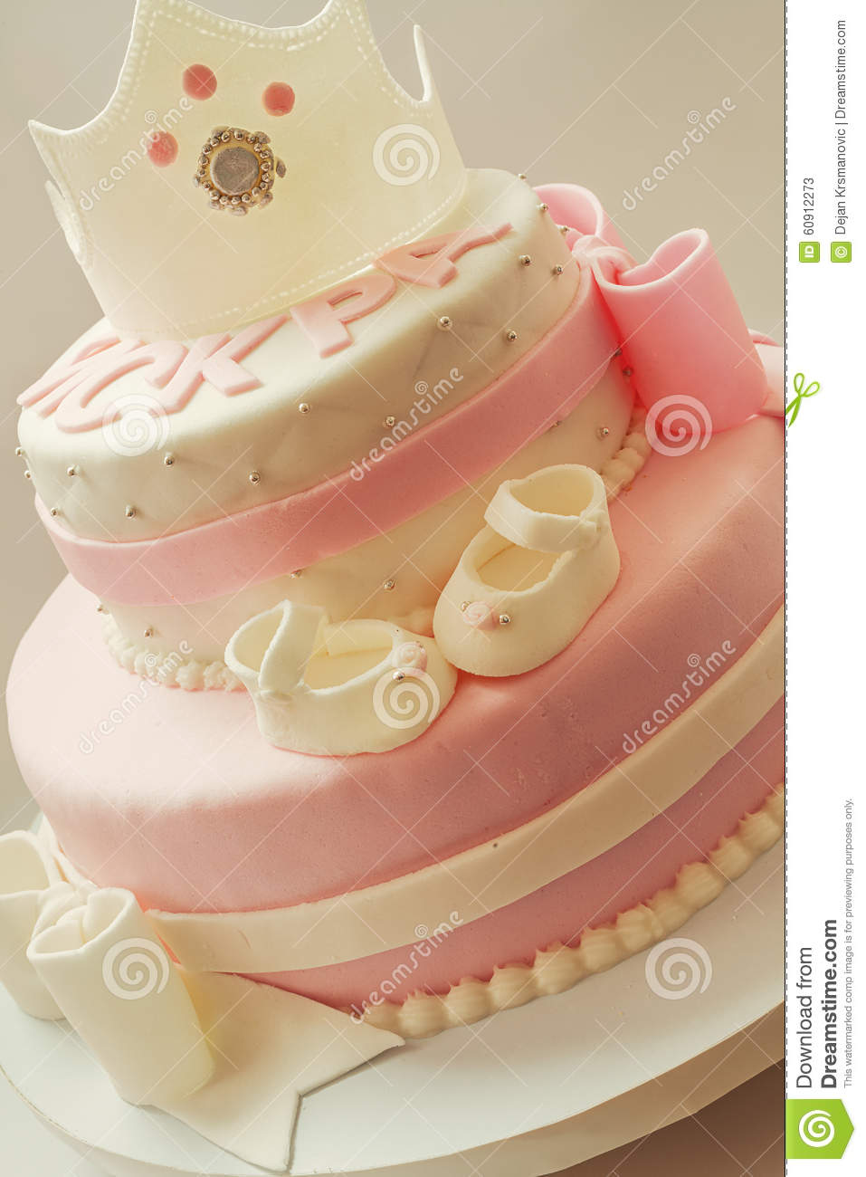 Birthday cake for baby queen stock photo image 60912273 for Baby footprints cake decoration