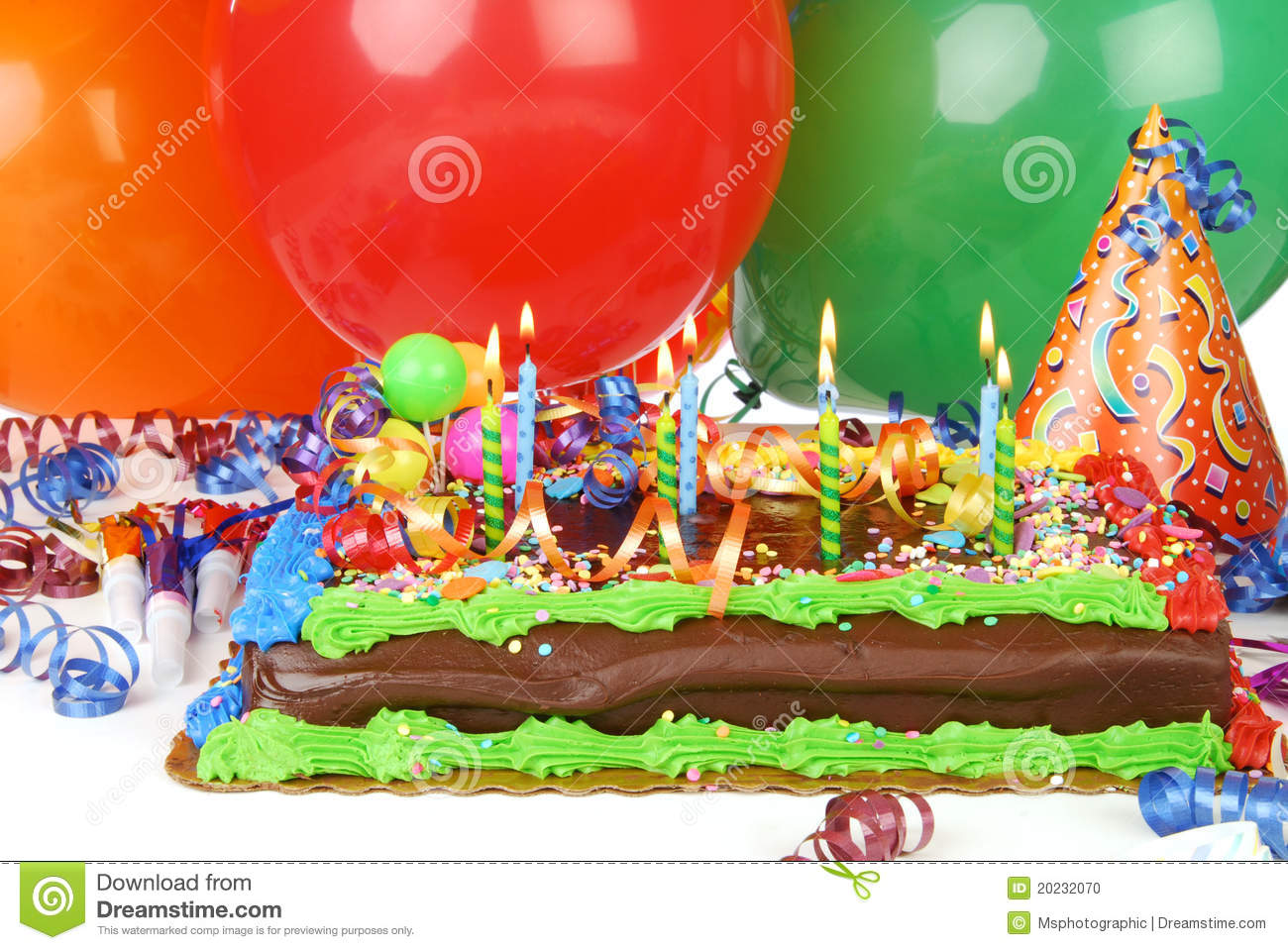 A Birthday Cake With Helium Balloons In The Background