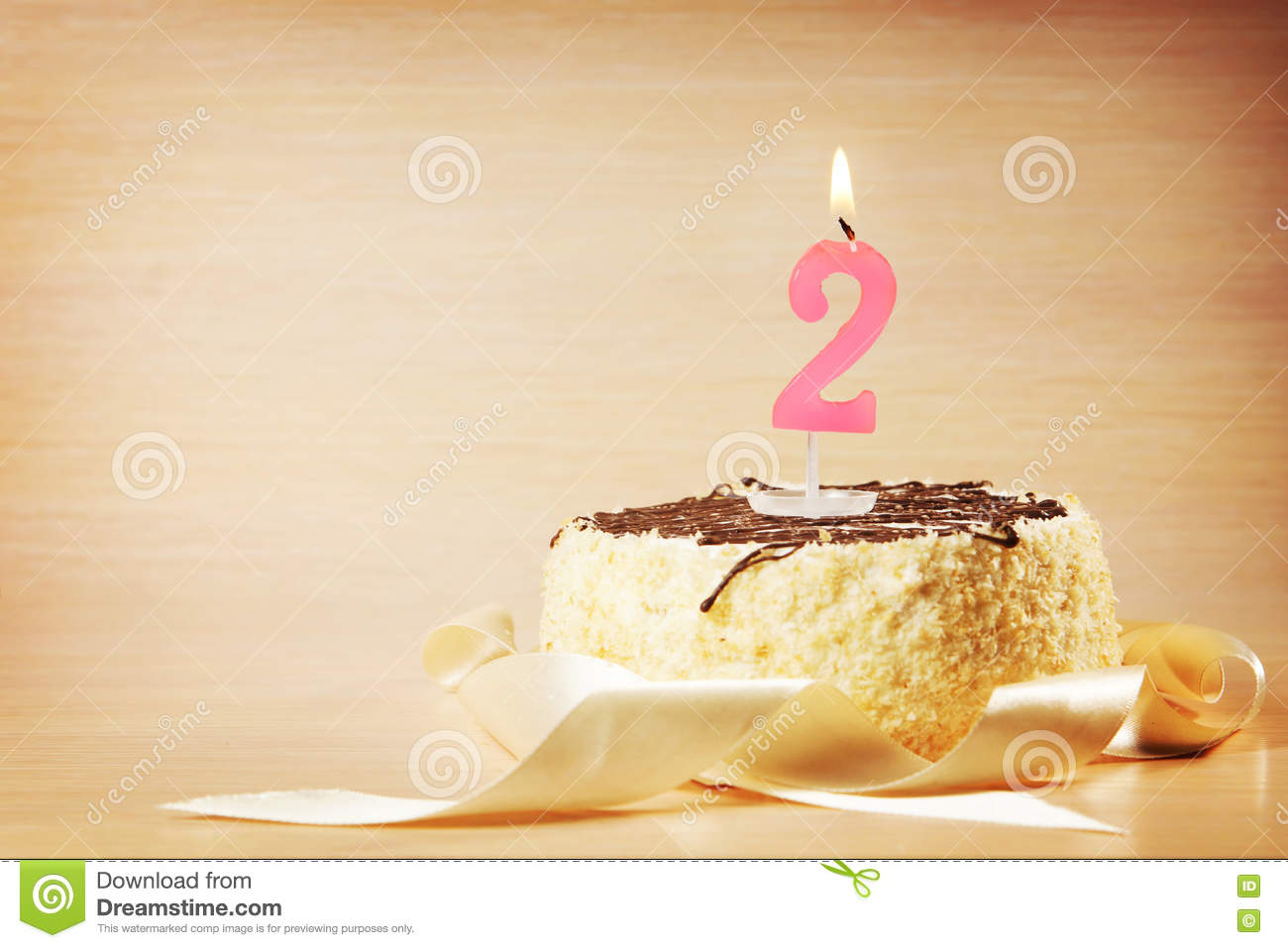 Birthday Cake With Burning Candle As A Number Two Stock Image