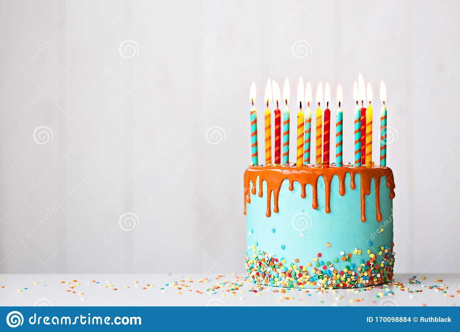 Excellent Birthday Cake With Candles And Drip Icing Stock Photo Image Of Funny Birthday Cards Online Hendilapandamsfinfo