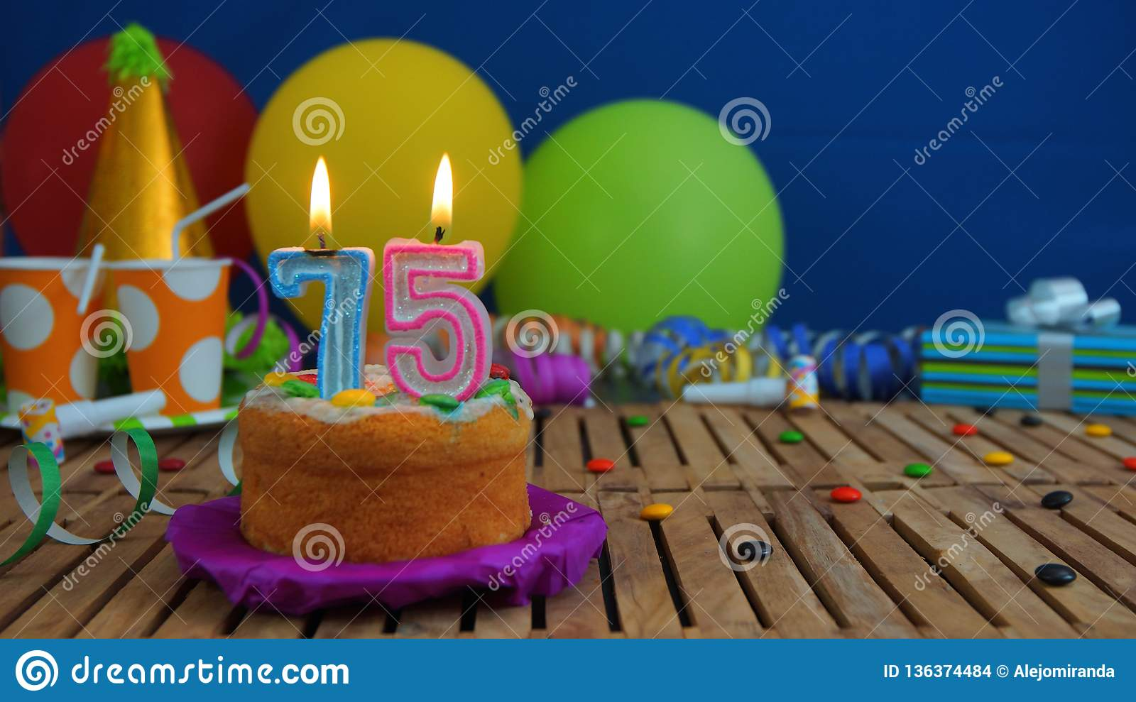 Birthday 75 Cake With Candles On Rustic Wooden Table Background Of Colorful Balloons Gifts