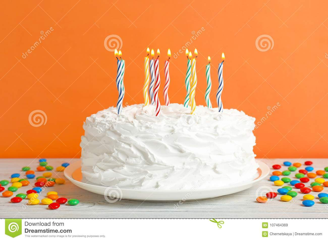 Birthday Cake With Candles On Table Against Wall Stock Image Image