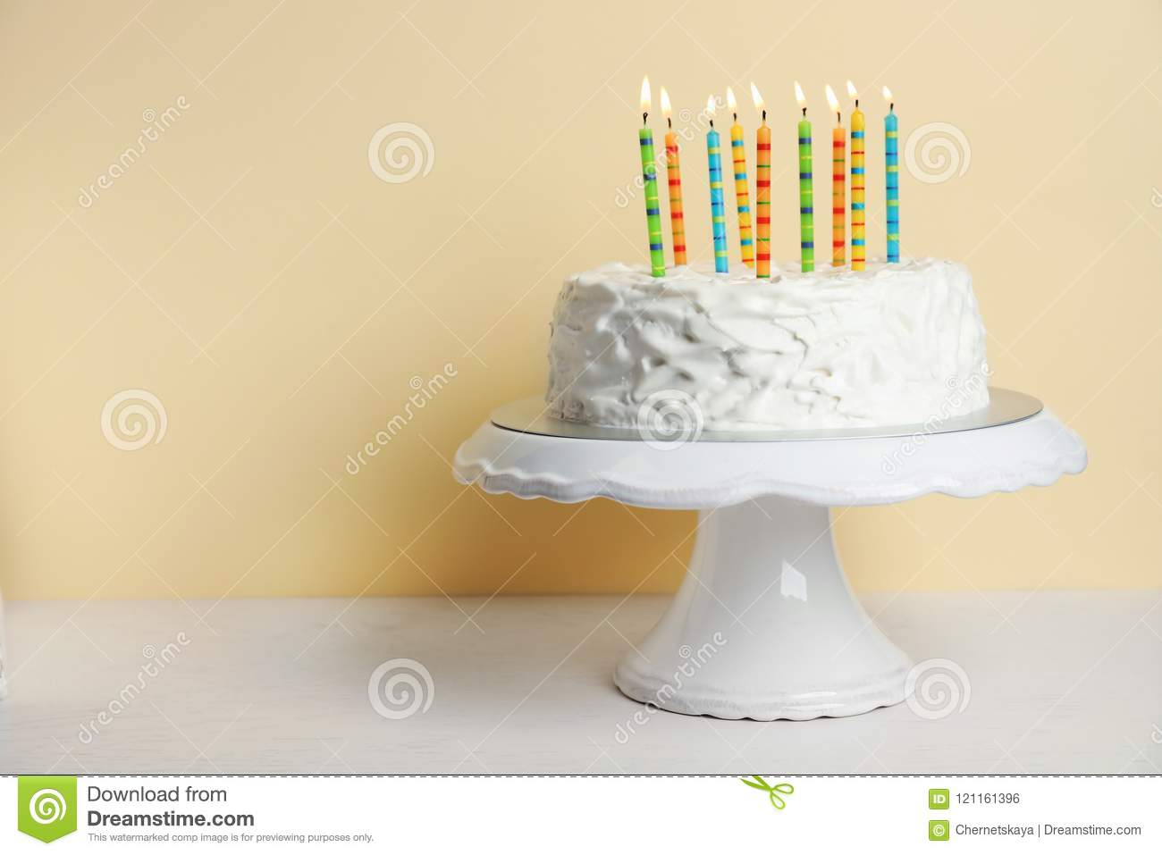Birthday cake with candles on table