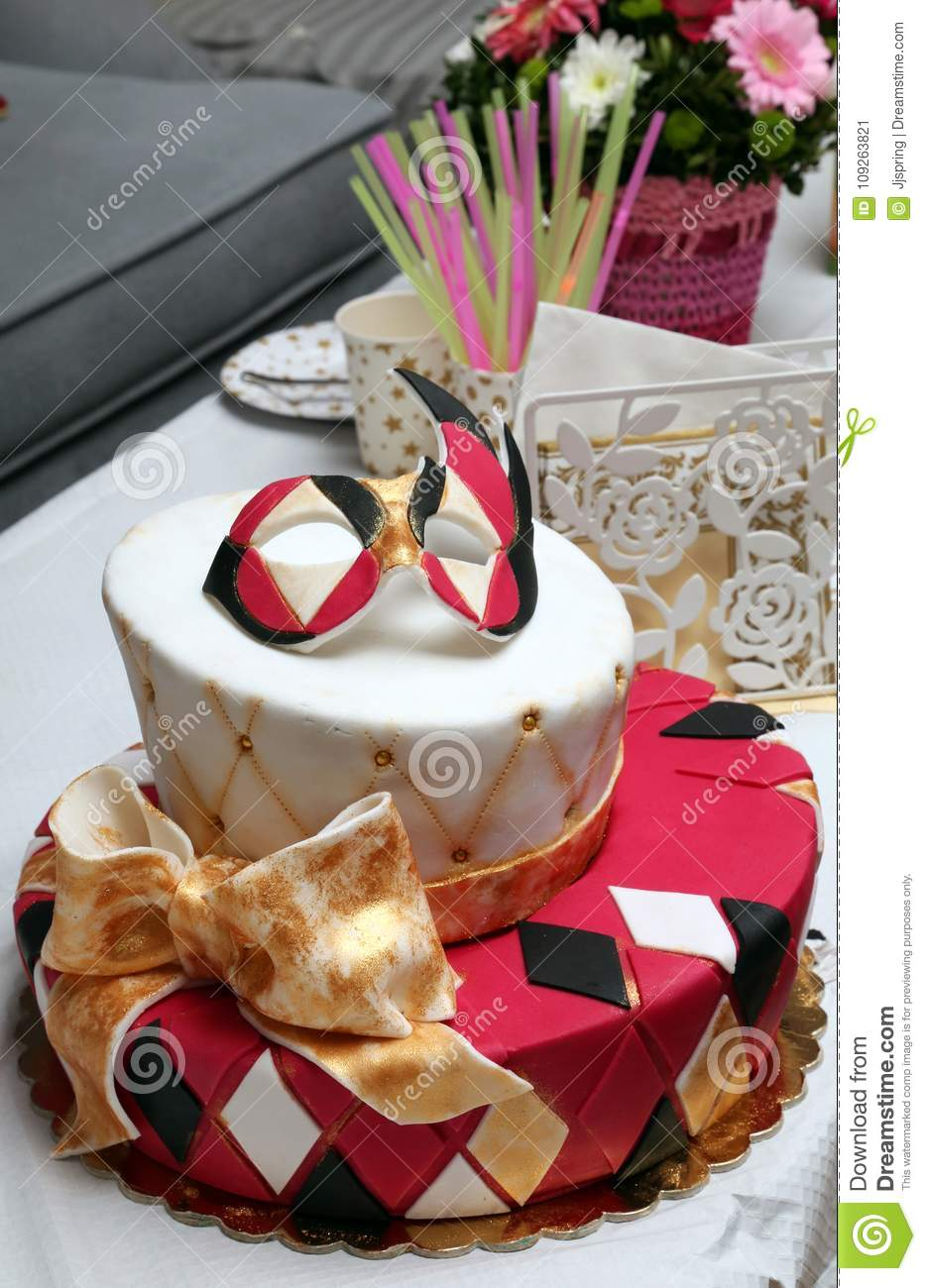 Birthday Cake Decorated With Mask And Bow Stock Image Image Of