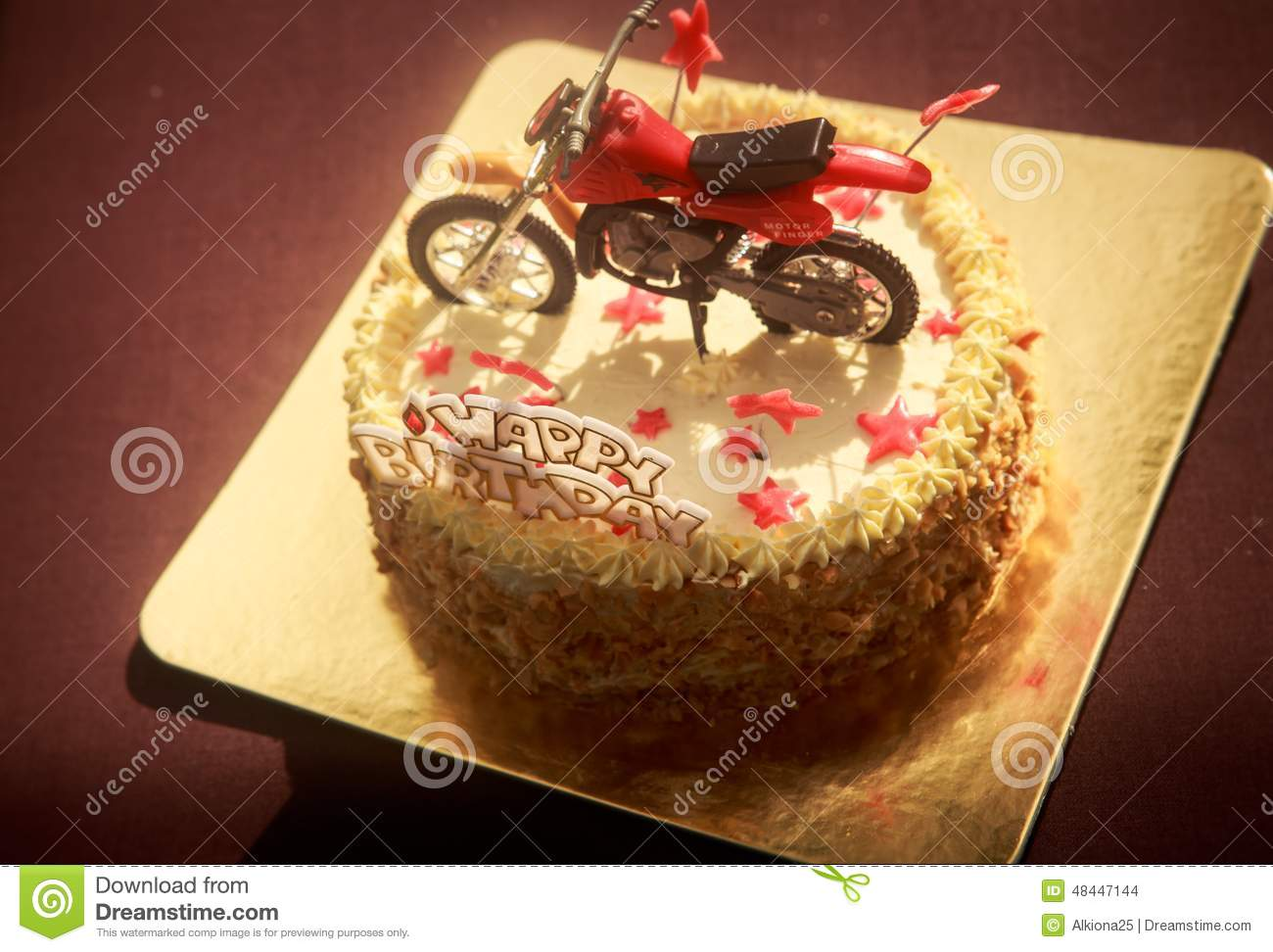 Birthday Cake Decorated With Motorcycle And Red Stars Stock Photo