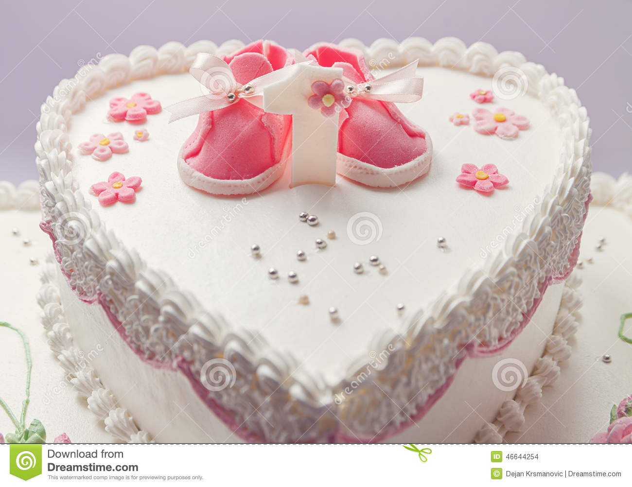 Details Of A Birthday Cake For Baby Girl Number One And Sweet Sugar Shoes On Top
