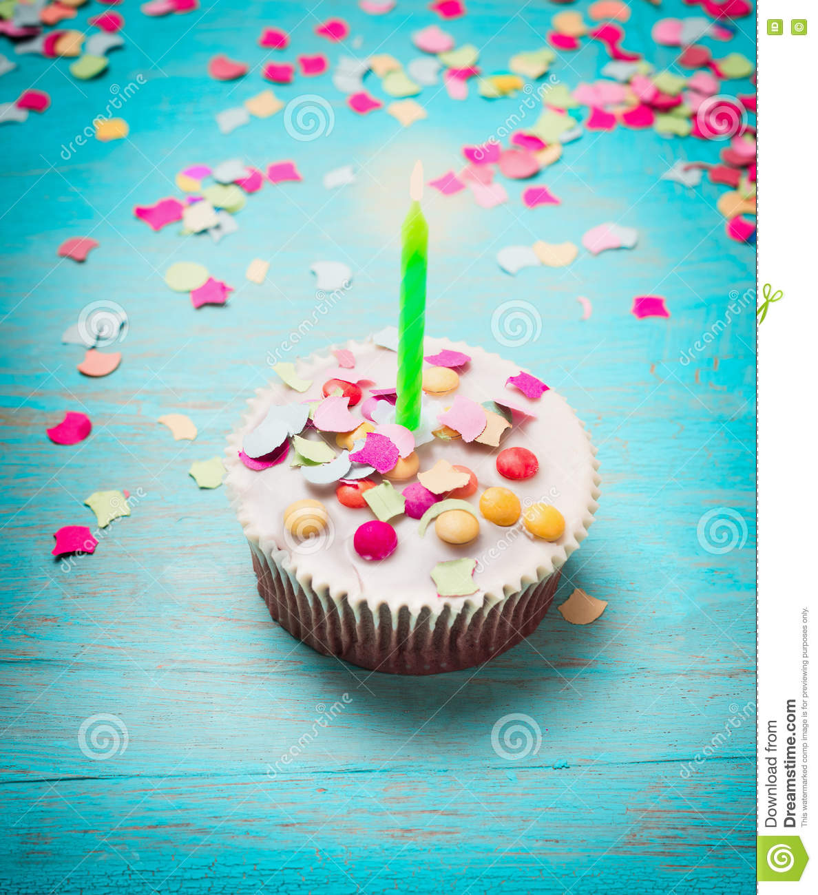 Birthday Cake With Green Candle And Pink Confetti On Turquoise Blue
