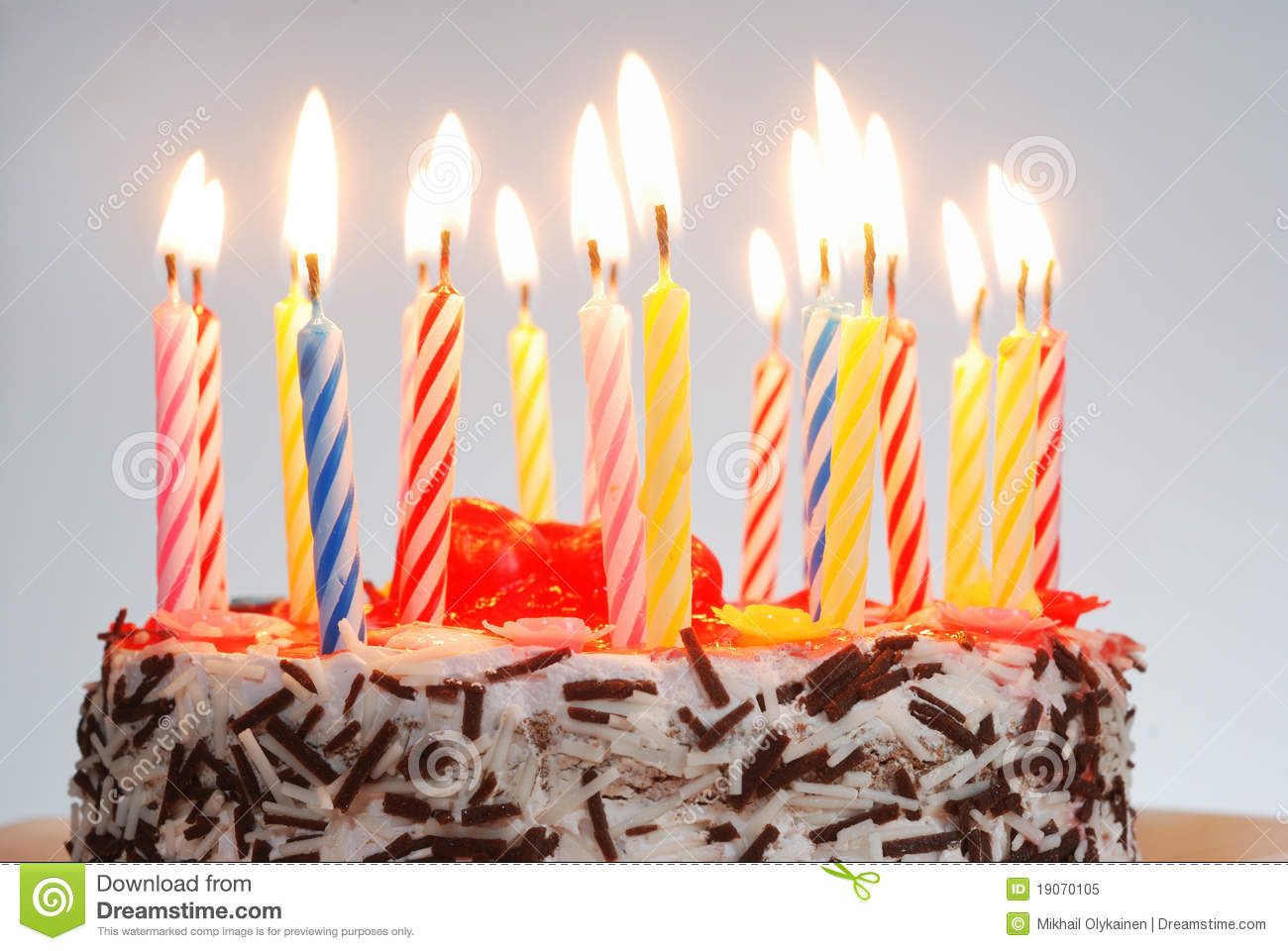 A Birthday Cake With Lighted Candles Royalty Free Stock