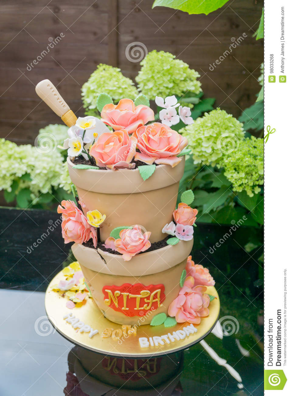 A Birthday Cake Made To Look Like Flower Pots