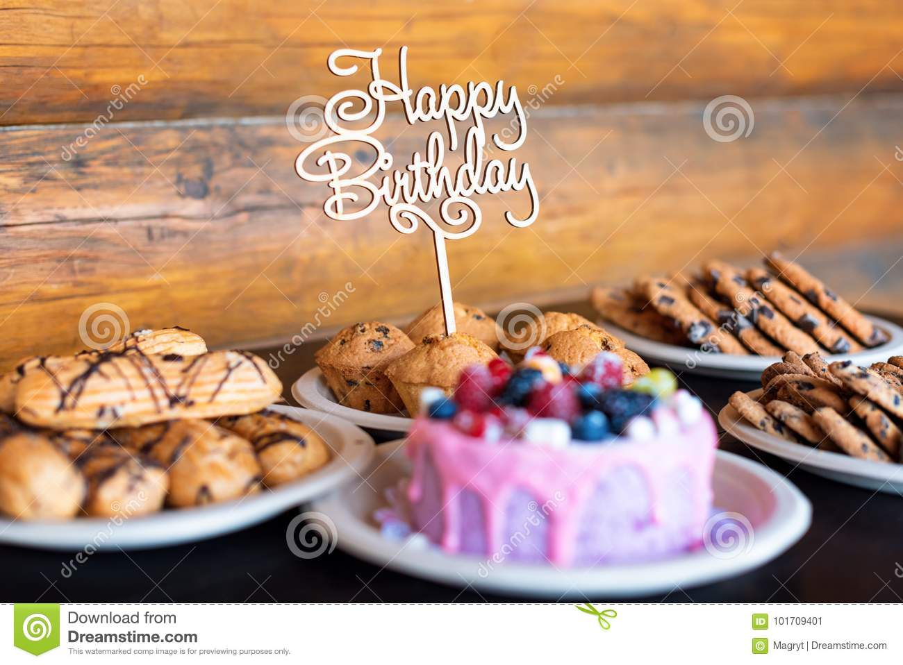 Download Birthday Cake And Muffins With Wooden Greeting Sign On Rustic Background Sing