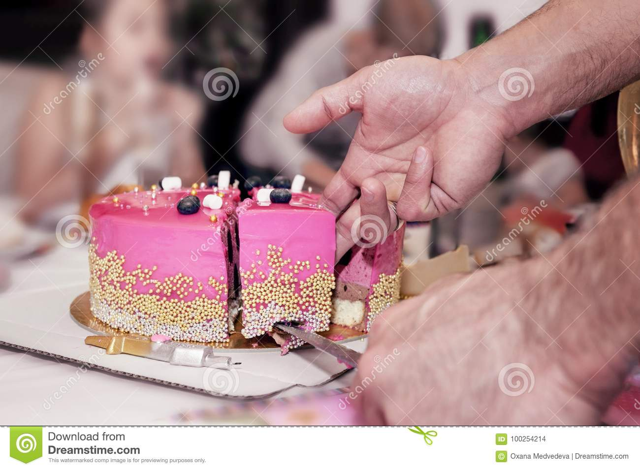 Birthday Cake Decorated With Pink Shiny High Polished Beads Cut Into Chunks Man Hands Closeup On Blurred Background