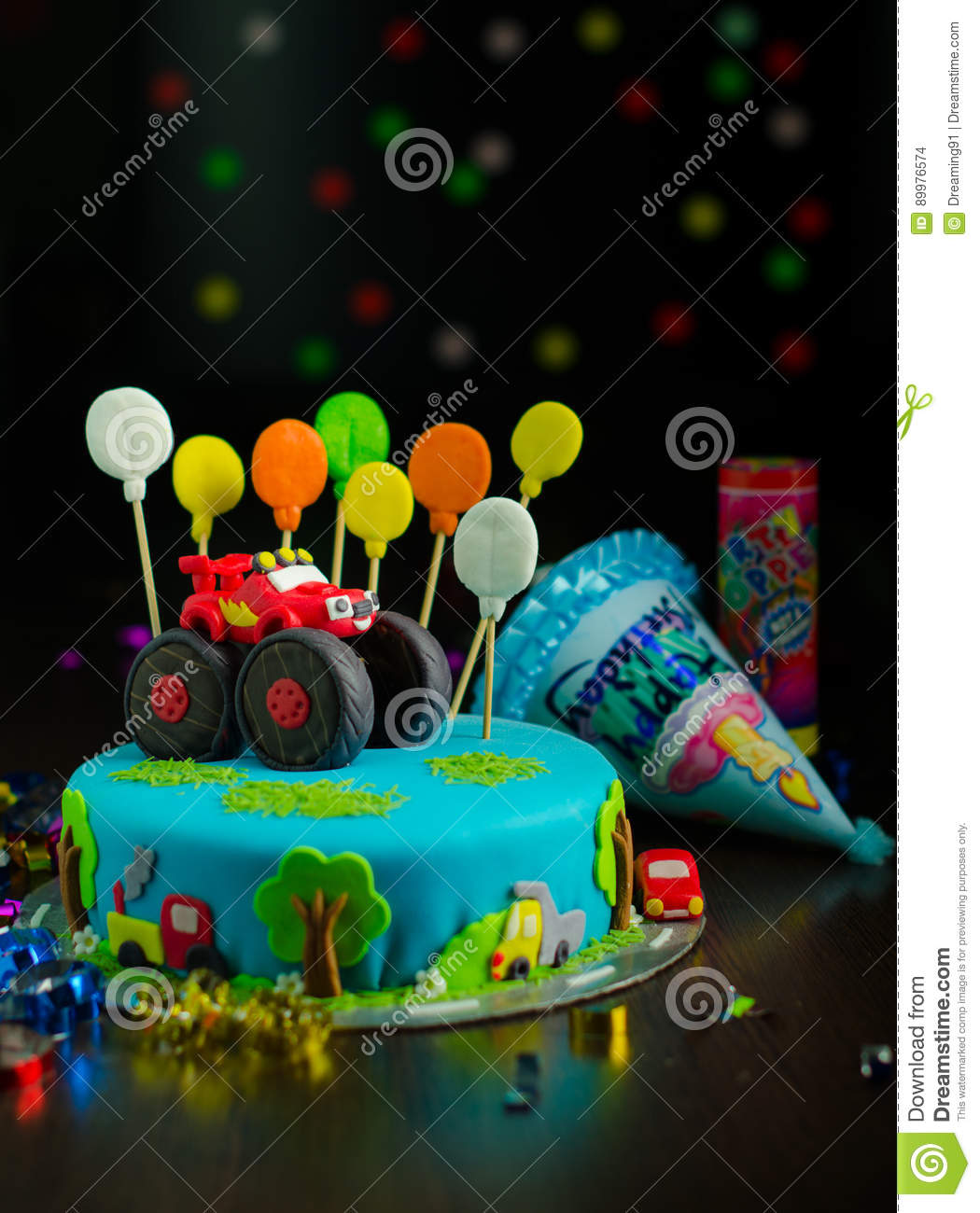 Birthday Cake With Red Car And Colorful Balloons On Top On The Bokeh